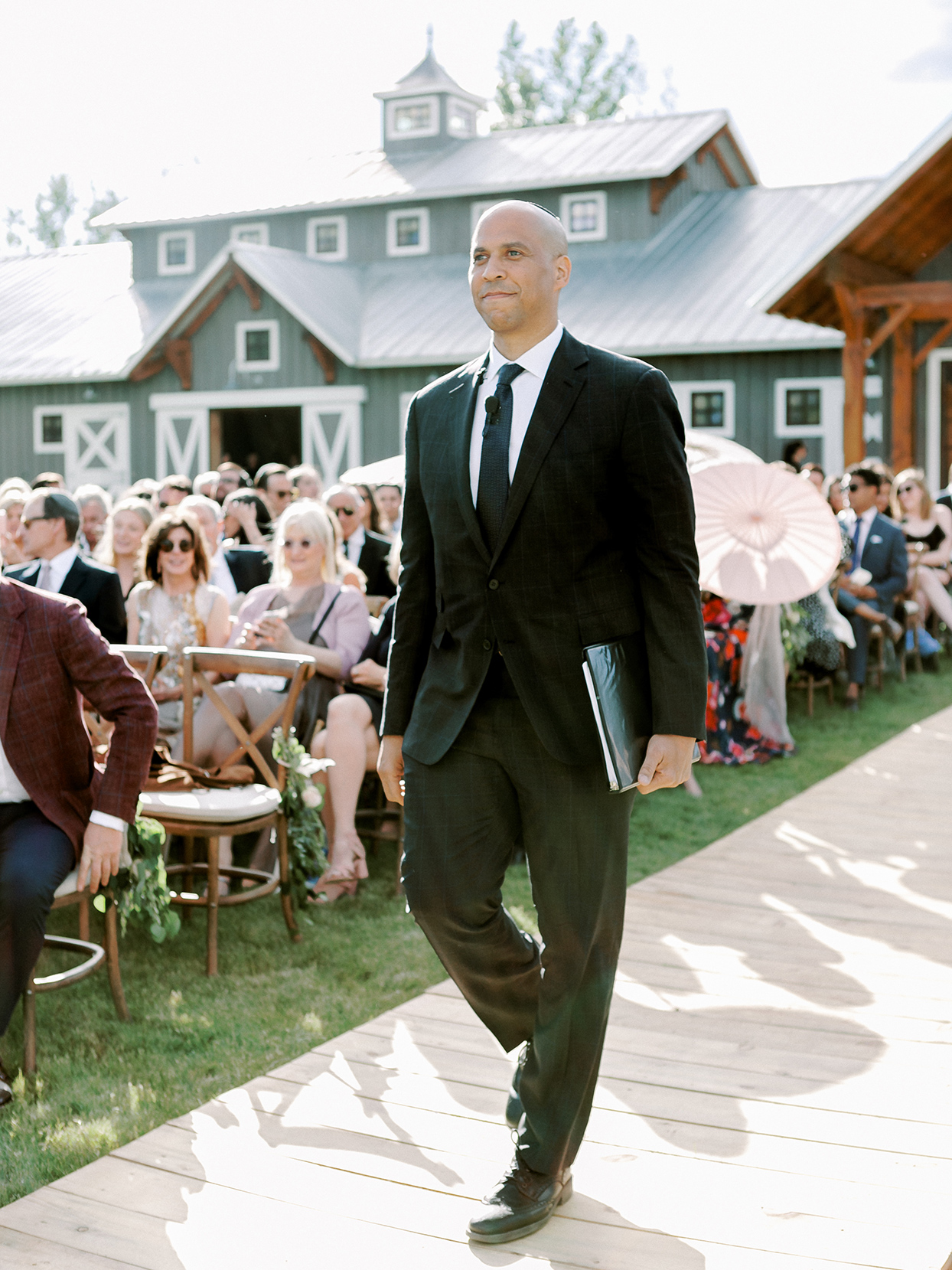 jessica aaron wedding officiant cory booker walking up aisle
