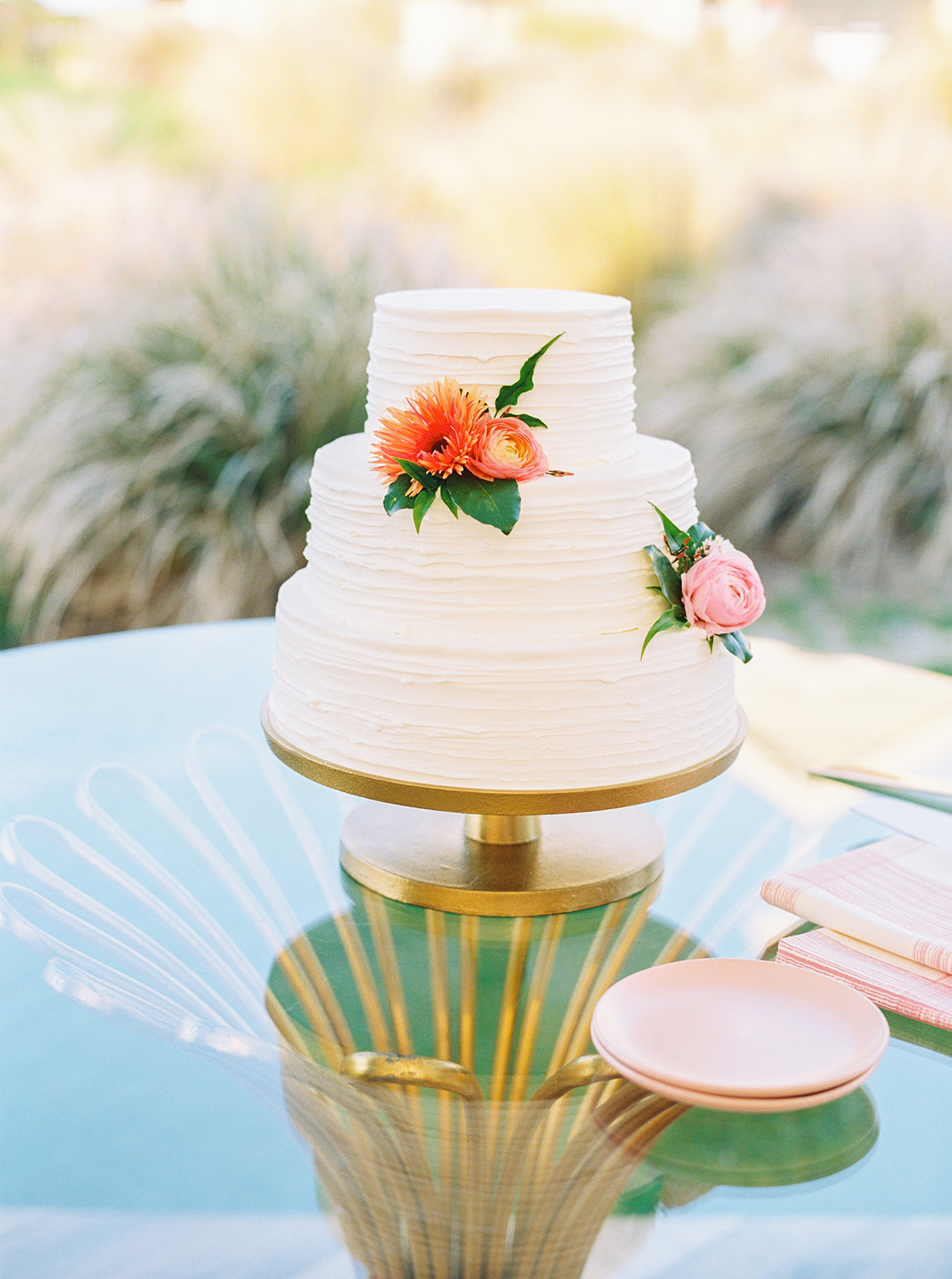 lauren dan simple white wedding cake with pink flowers