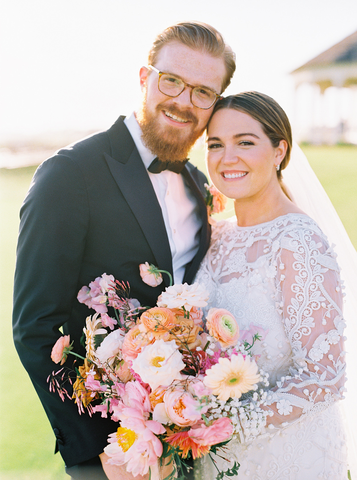 lauren dan wedding couple smiling with floral bouquet