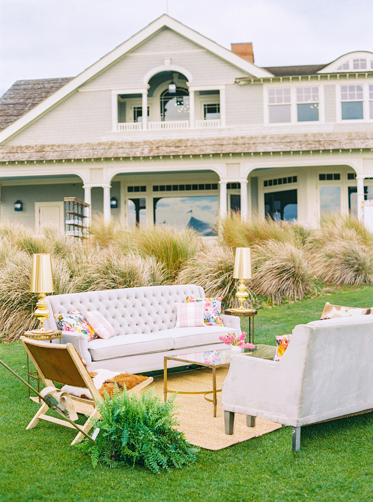 lauren dan outdoor wedding lounge area in front of beach house
