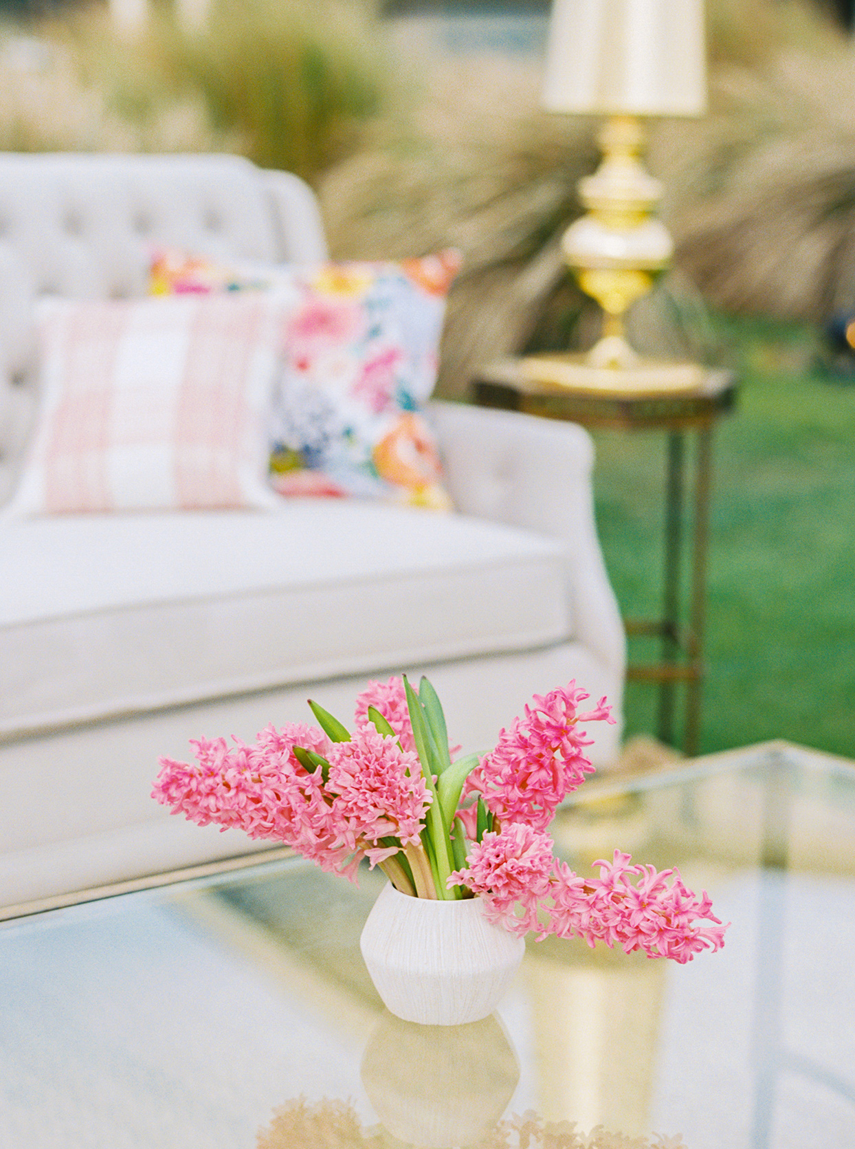 lauren dan wedding pink floral arrangement in lounge area