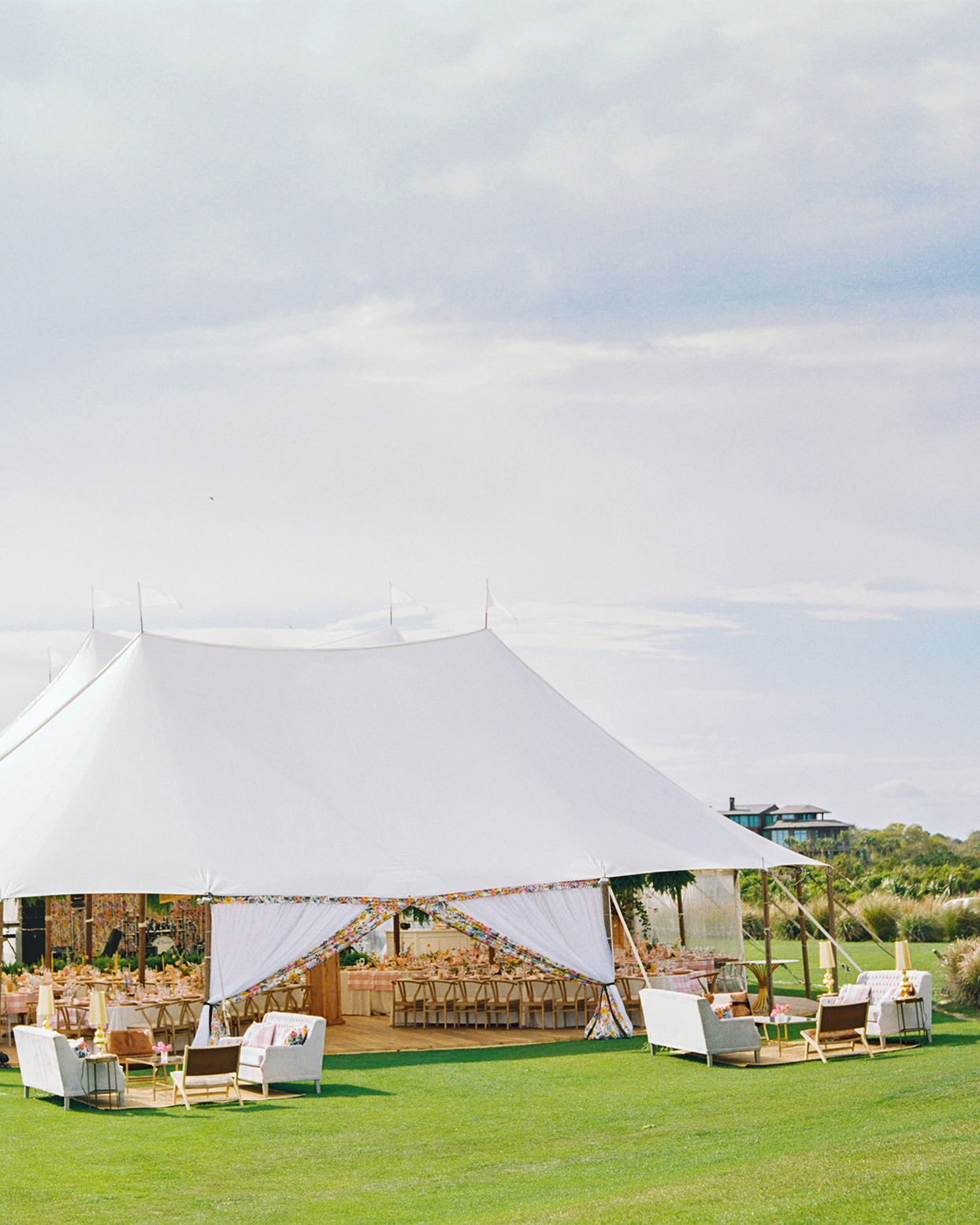 lauren dan wedding tent with wooden floor and reception tables