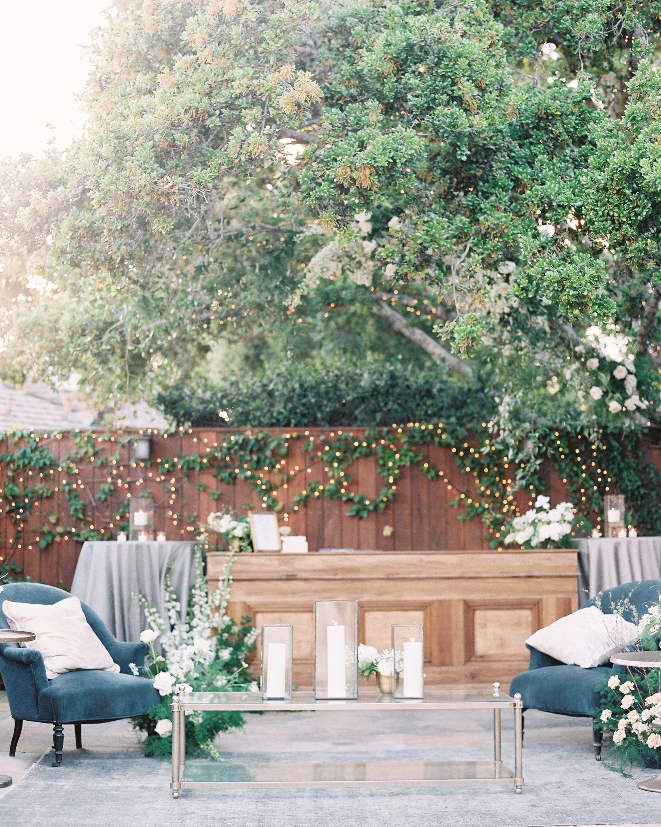 outdoor wedding lounge with greenery decor