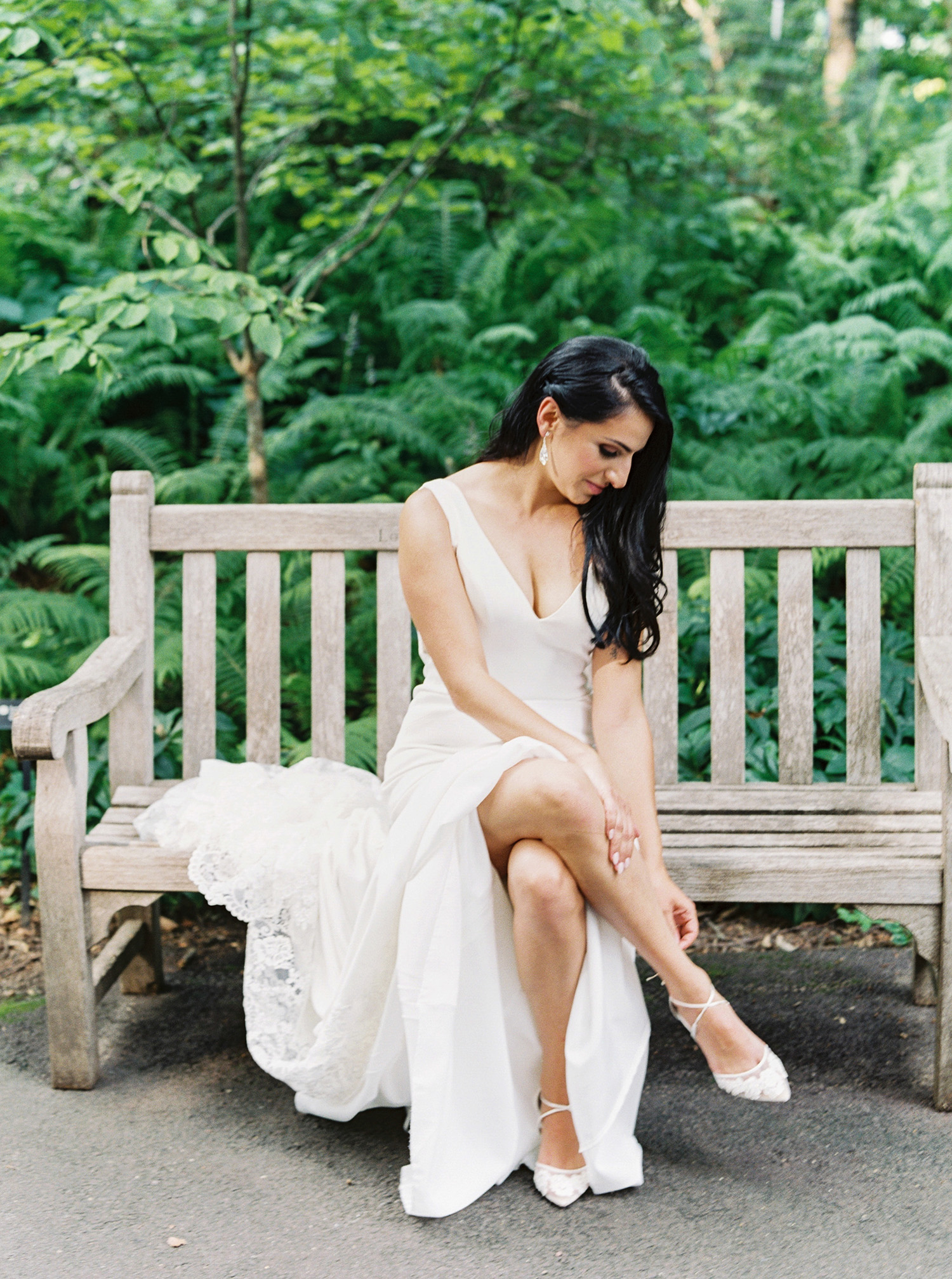 noel mike wedding bride sitting on bench with shoes