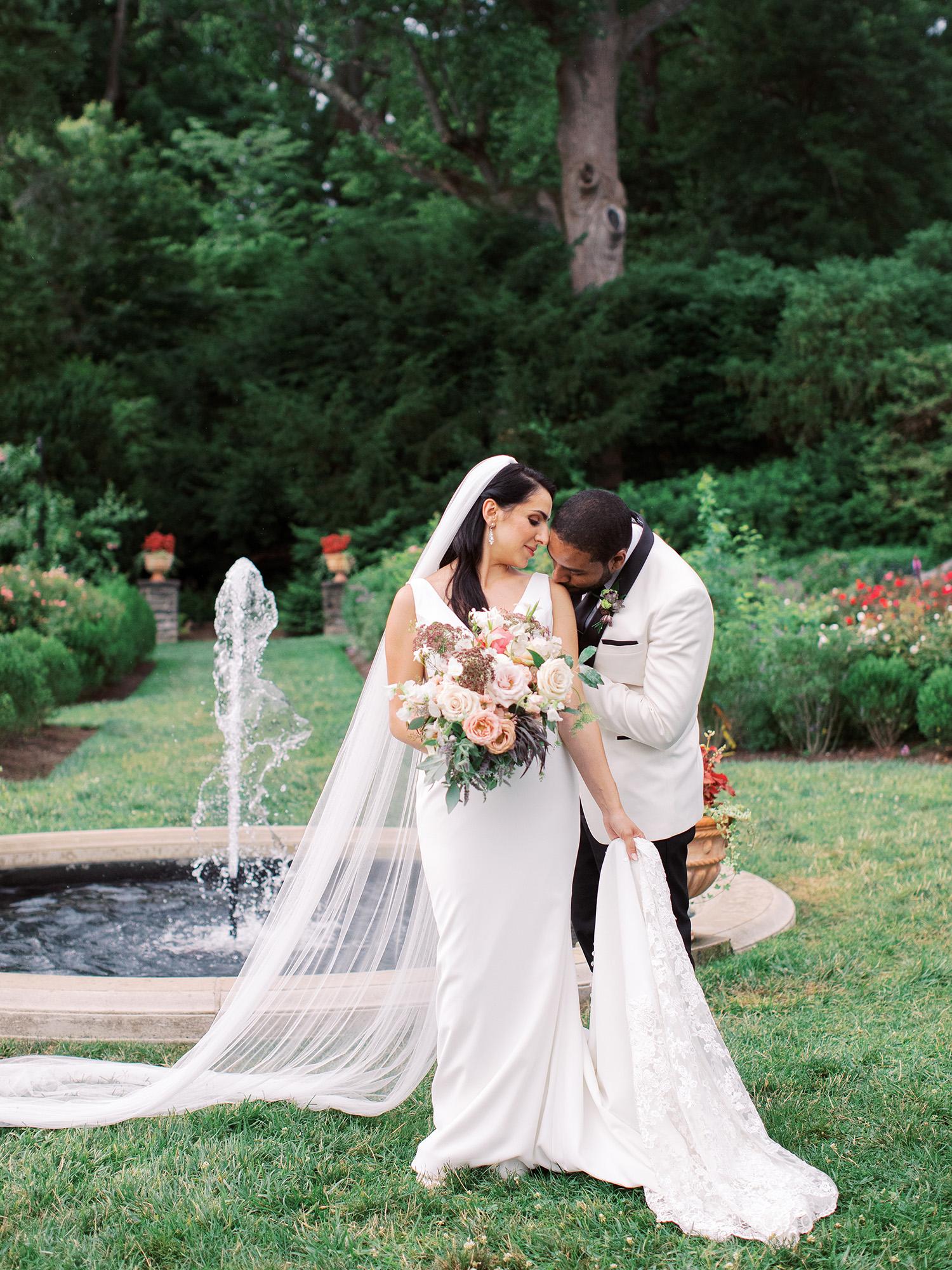 noel mike wedding couple shoulder kiss