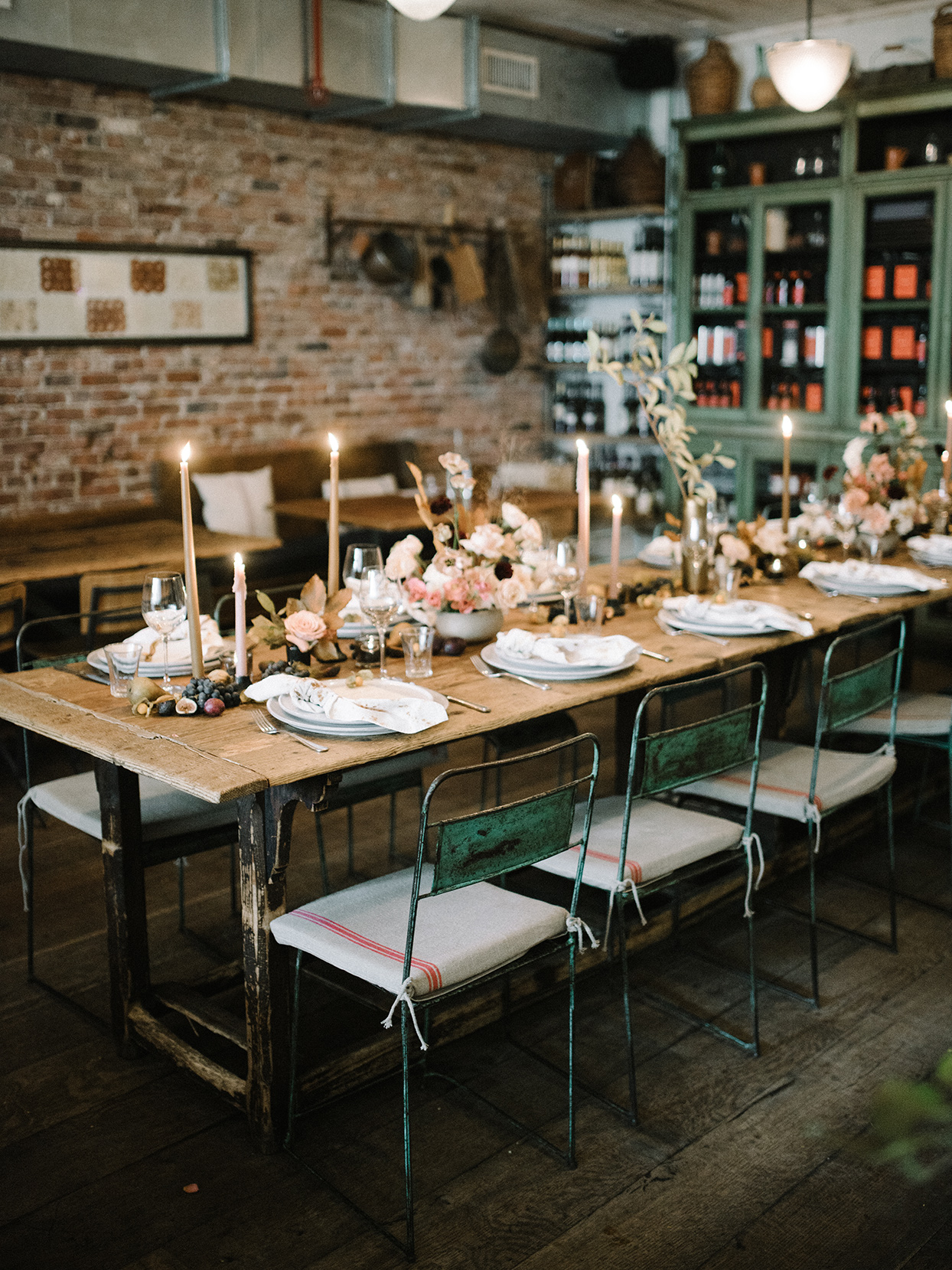 rustic wooden wedding reception tables with industrial chairs