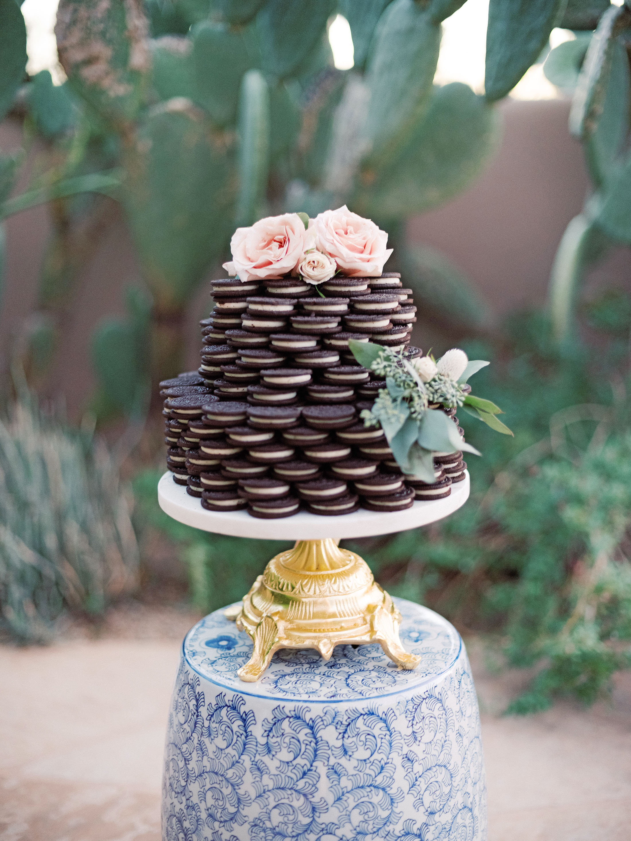 stack of oreos with flowers on cake tray