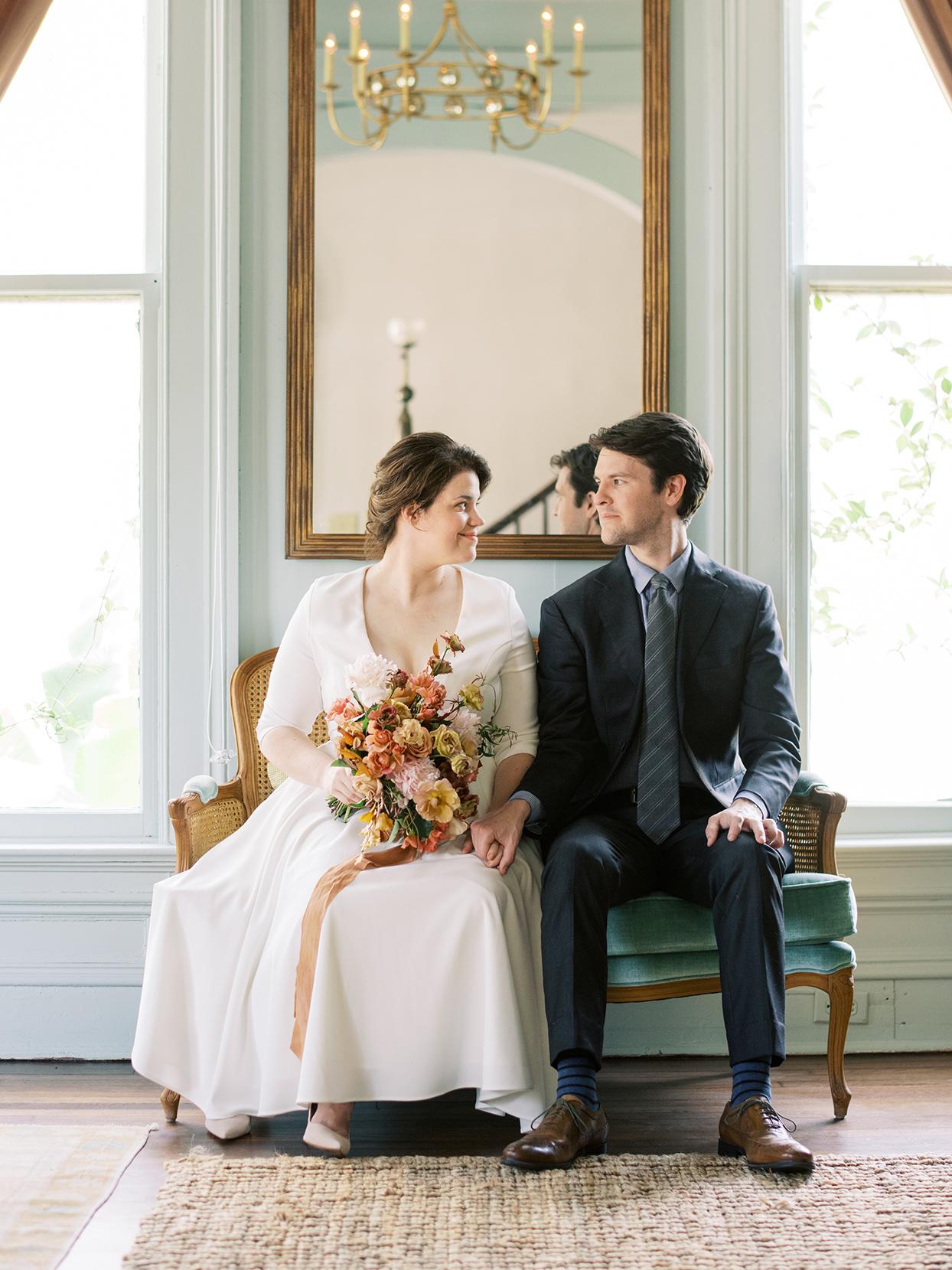 elizabeth scott wedding couple sitting in antique chairs by window