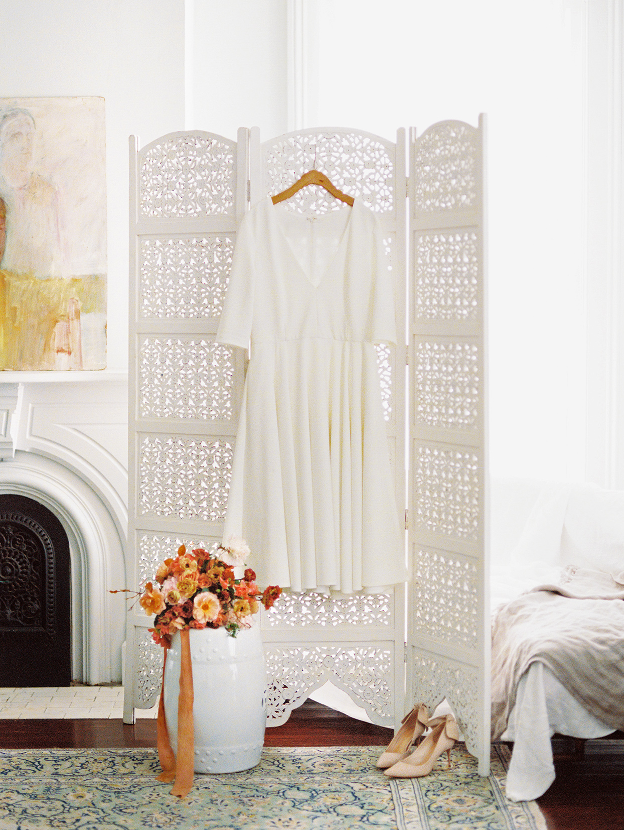 elizabeth scott wedding dress hanging in room