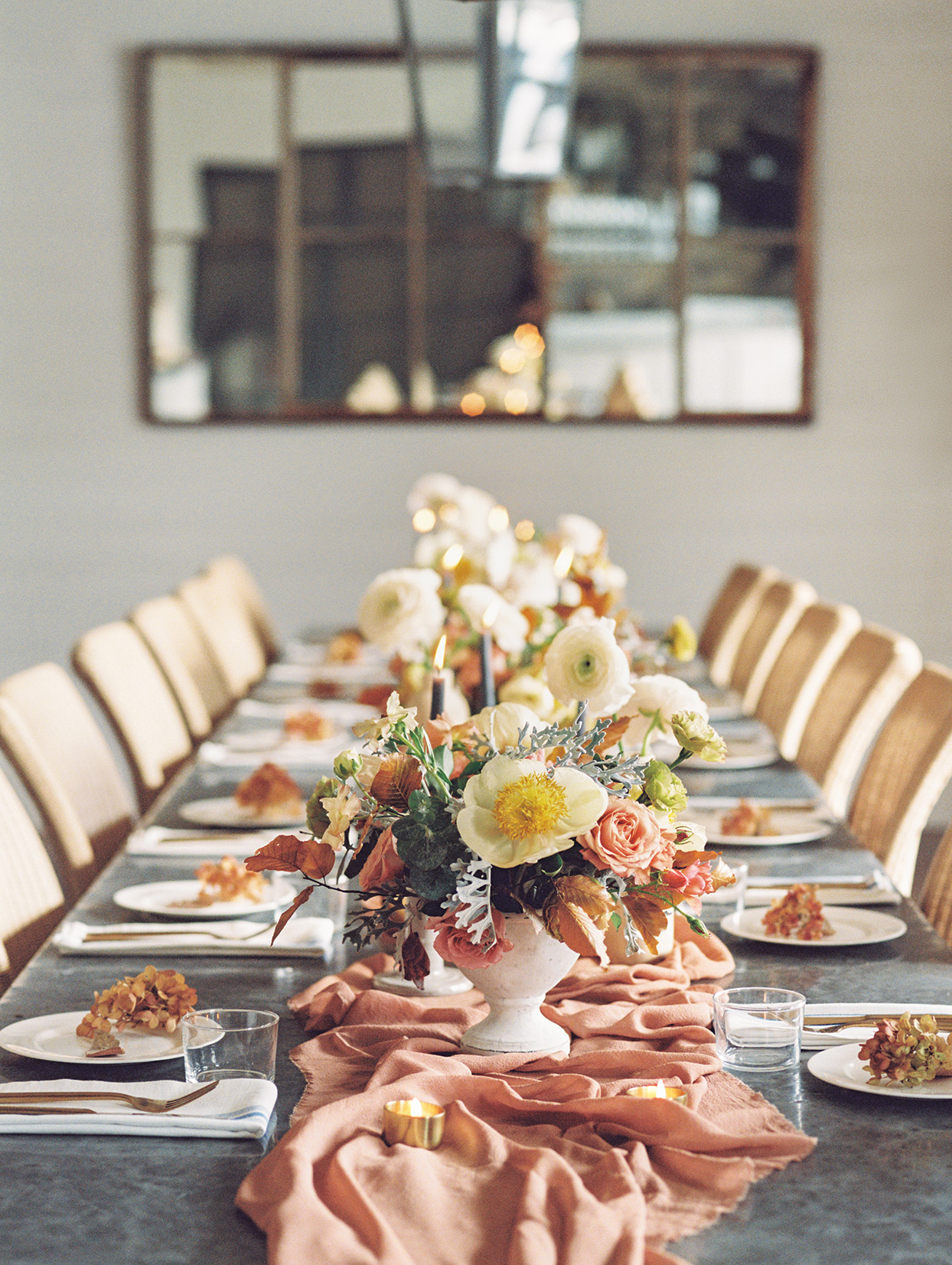 elizabeth scott wedding reception long table with orange and yellow decorations
