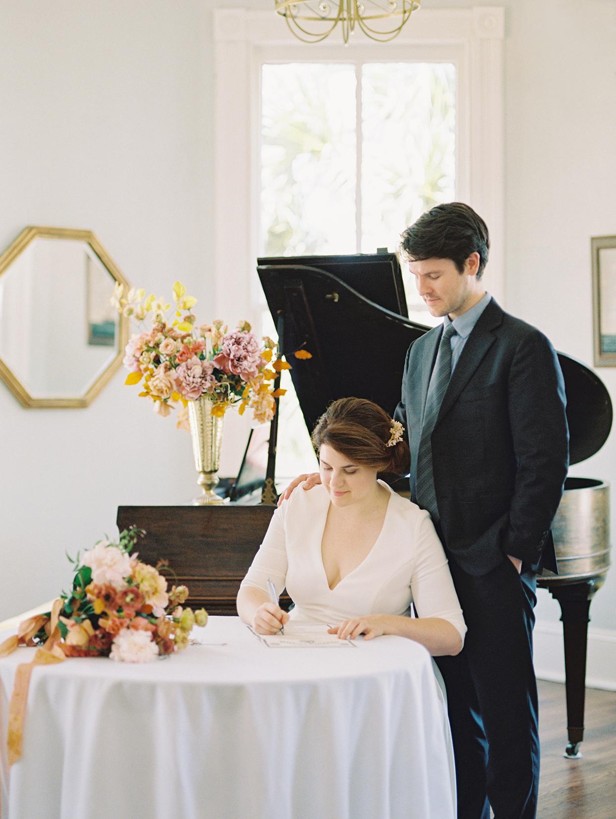 elizabeth scott wedding couple signing marriage documents