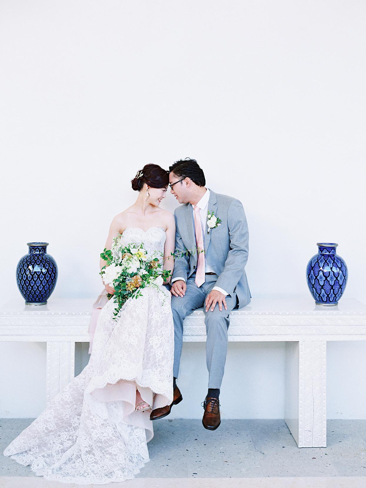 kirsten deran wedding couple sitting on white table