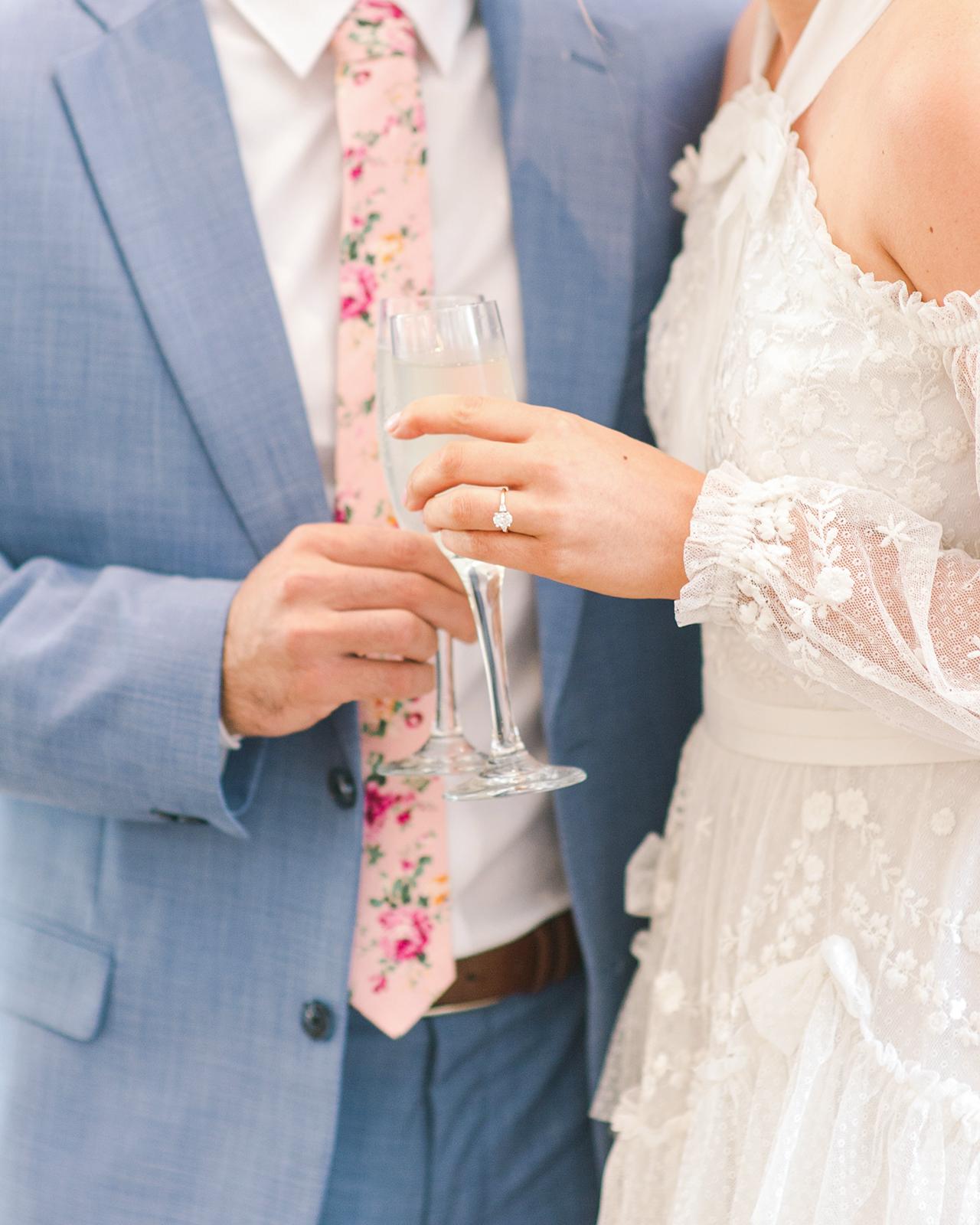 bride groom engagement ring wine glasses