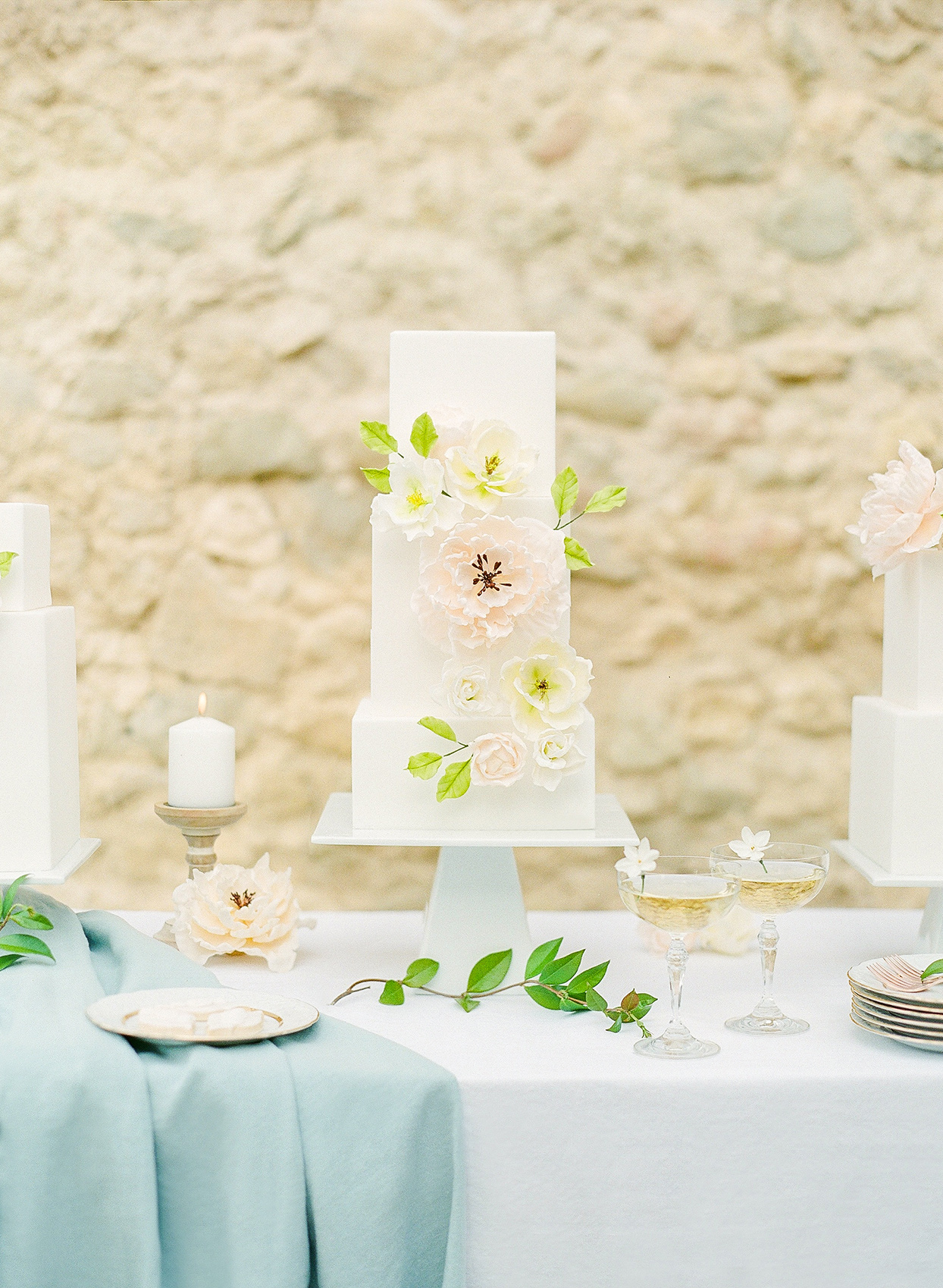 three tiered square white wedding cake