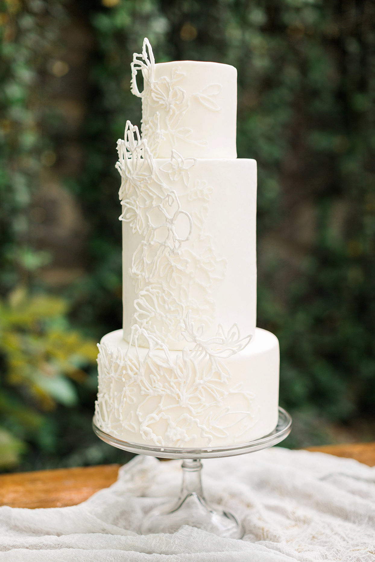 white wedding cake with sugar lattice