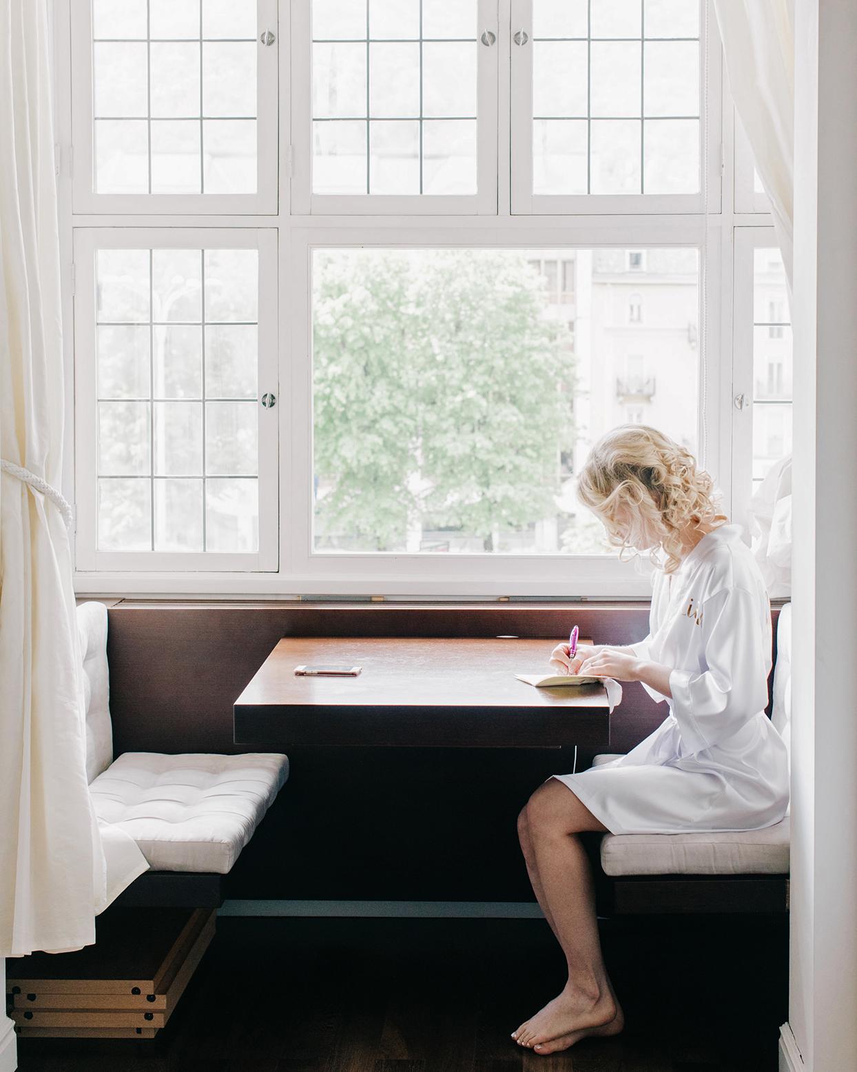 kiira arthur wedding bride writing vows by window