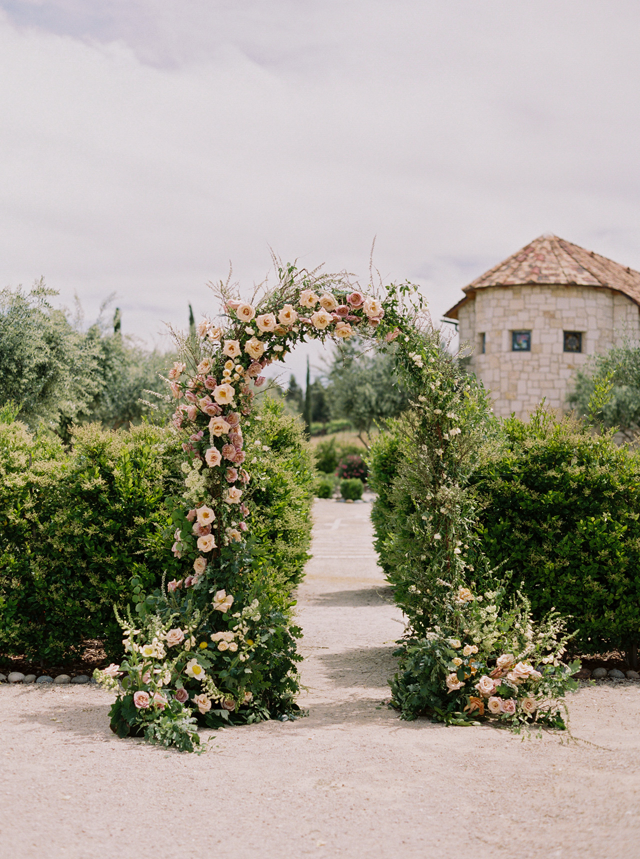 outdoor wedding ceremony floral arch