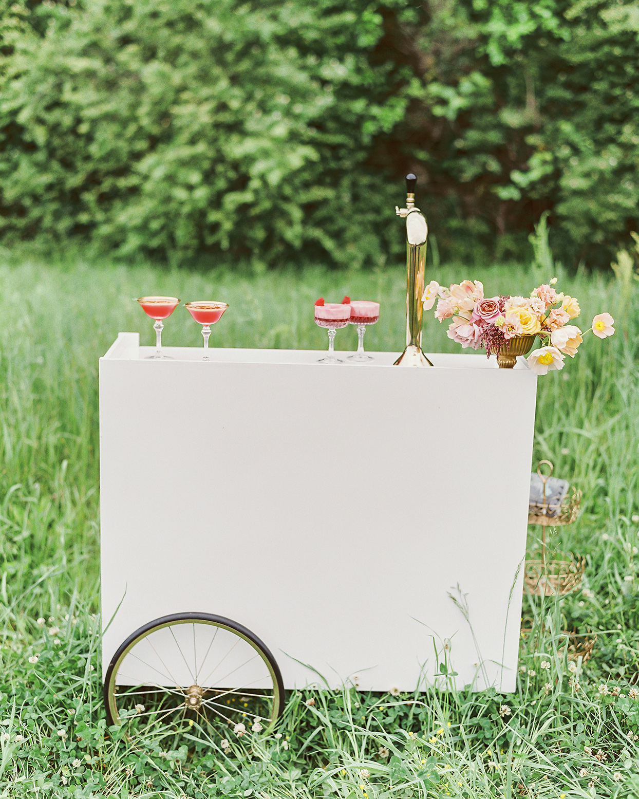 champagne wedding ideas cart with tap and flowers