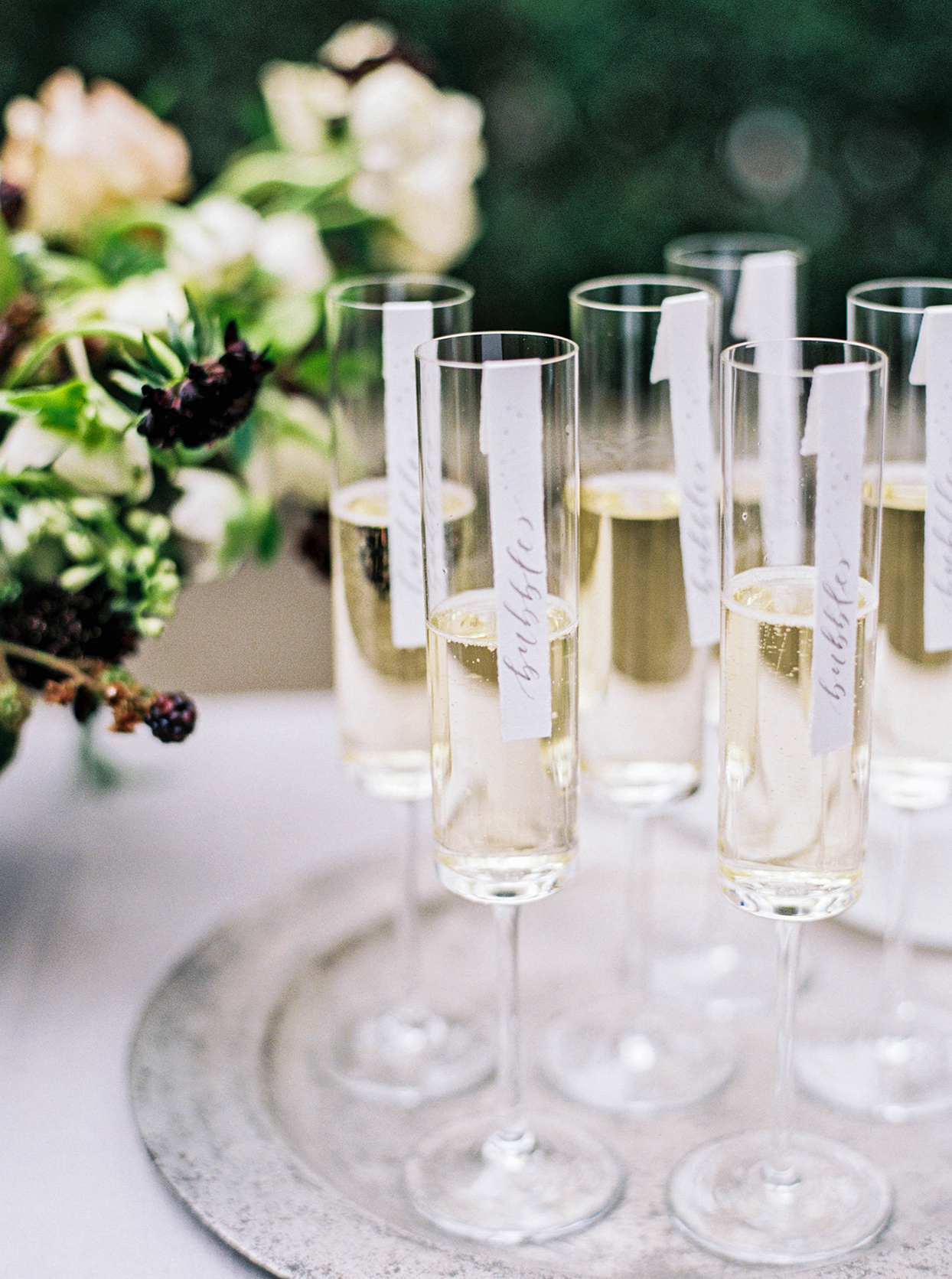 champagne wedding ideas flutes on silver platter