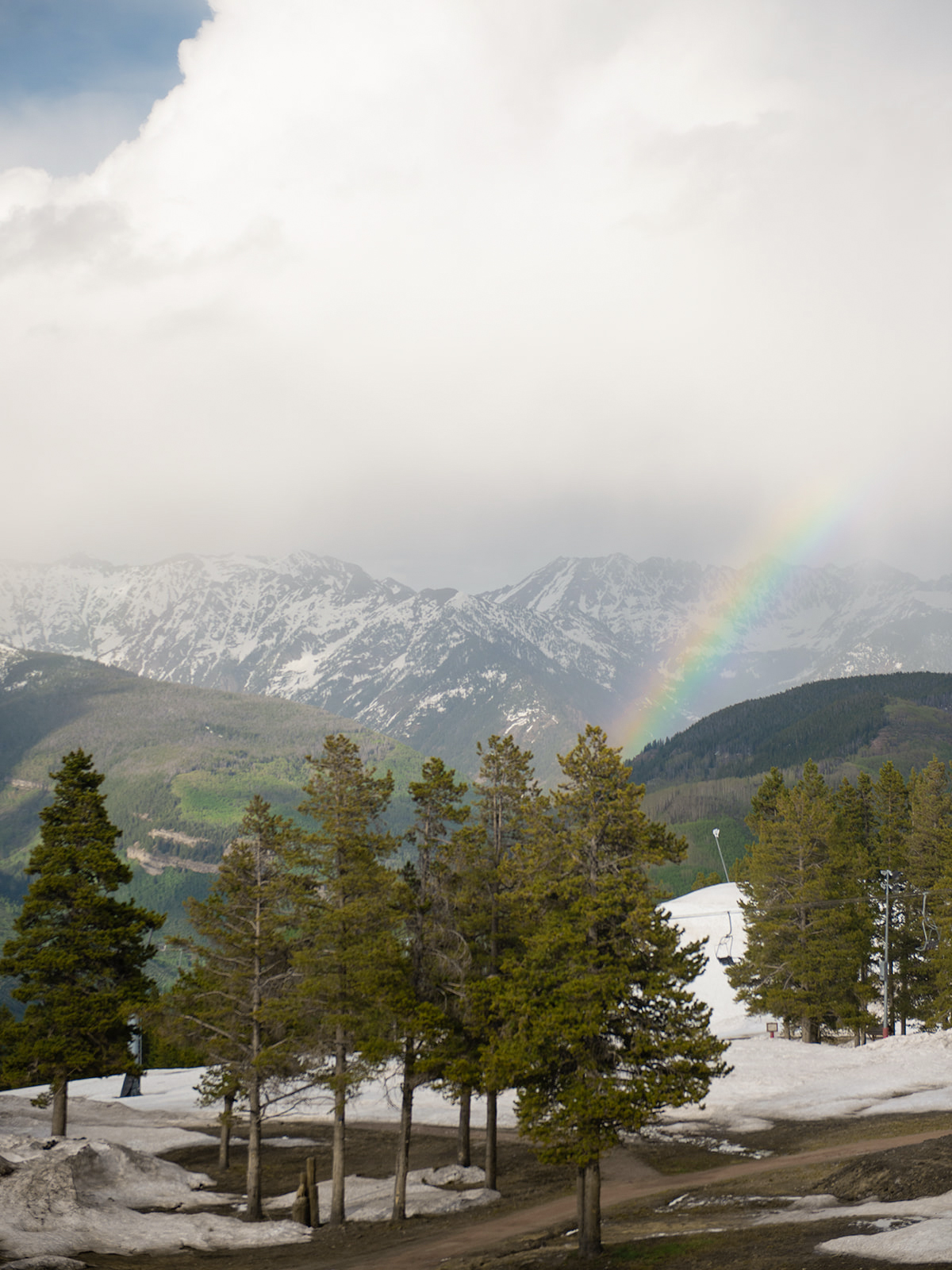 Colorado mountain view fog rainbow scene