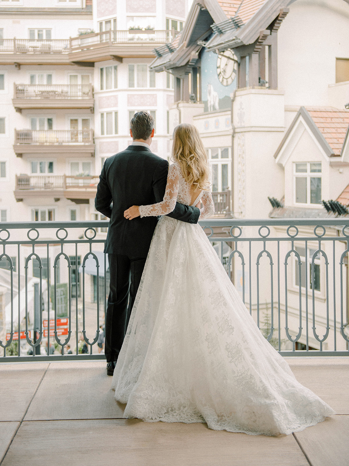 bride groom enjoy city view balcony