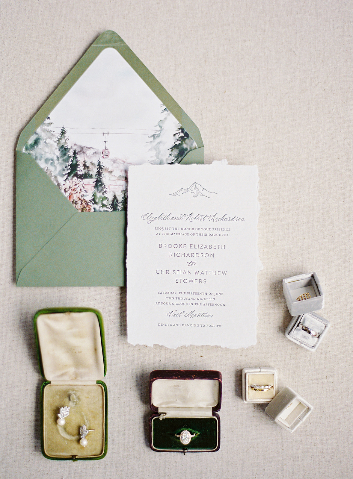 green envelope mountain theme invitations