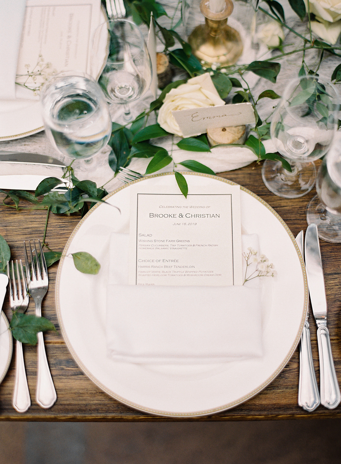 wedding reception wooden tables place setting floral arrangement menu
