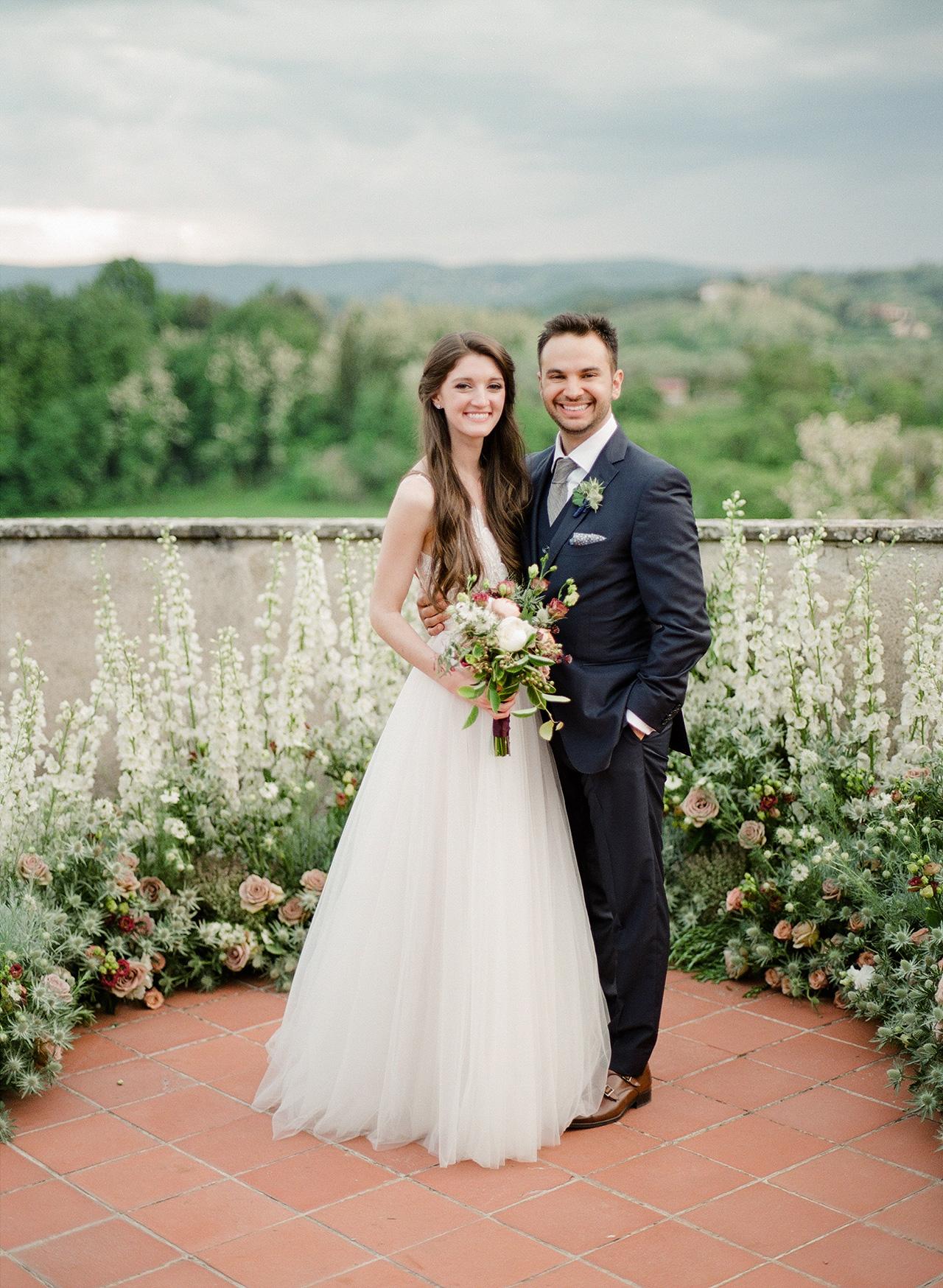 bride groom wedding pose country side backdrop