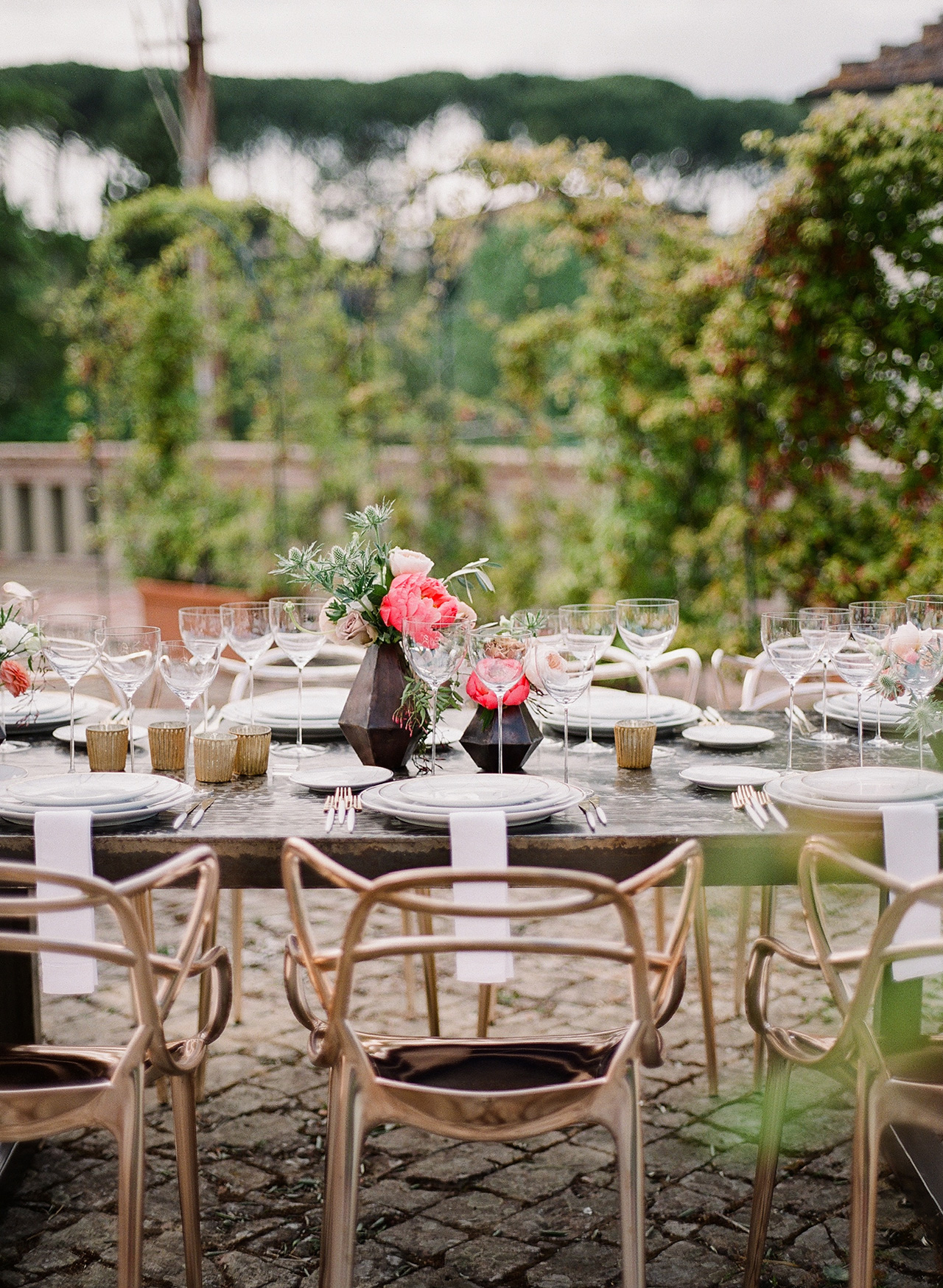 gold utensils white place settings dinnerware outdoors
