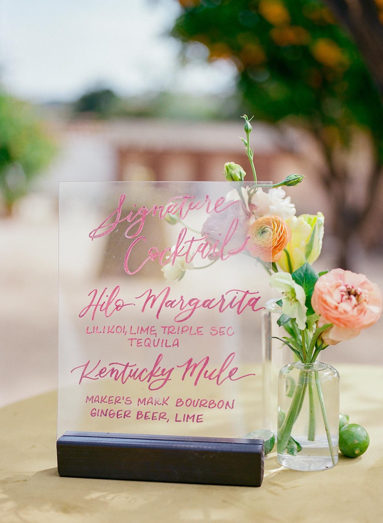 nina devon wedding cocktail menu on translucent glass