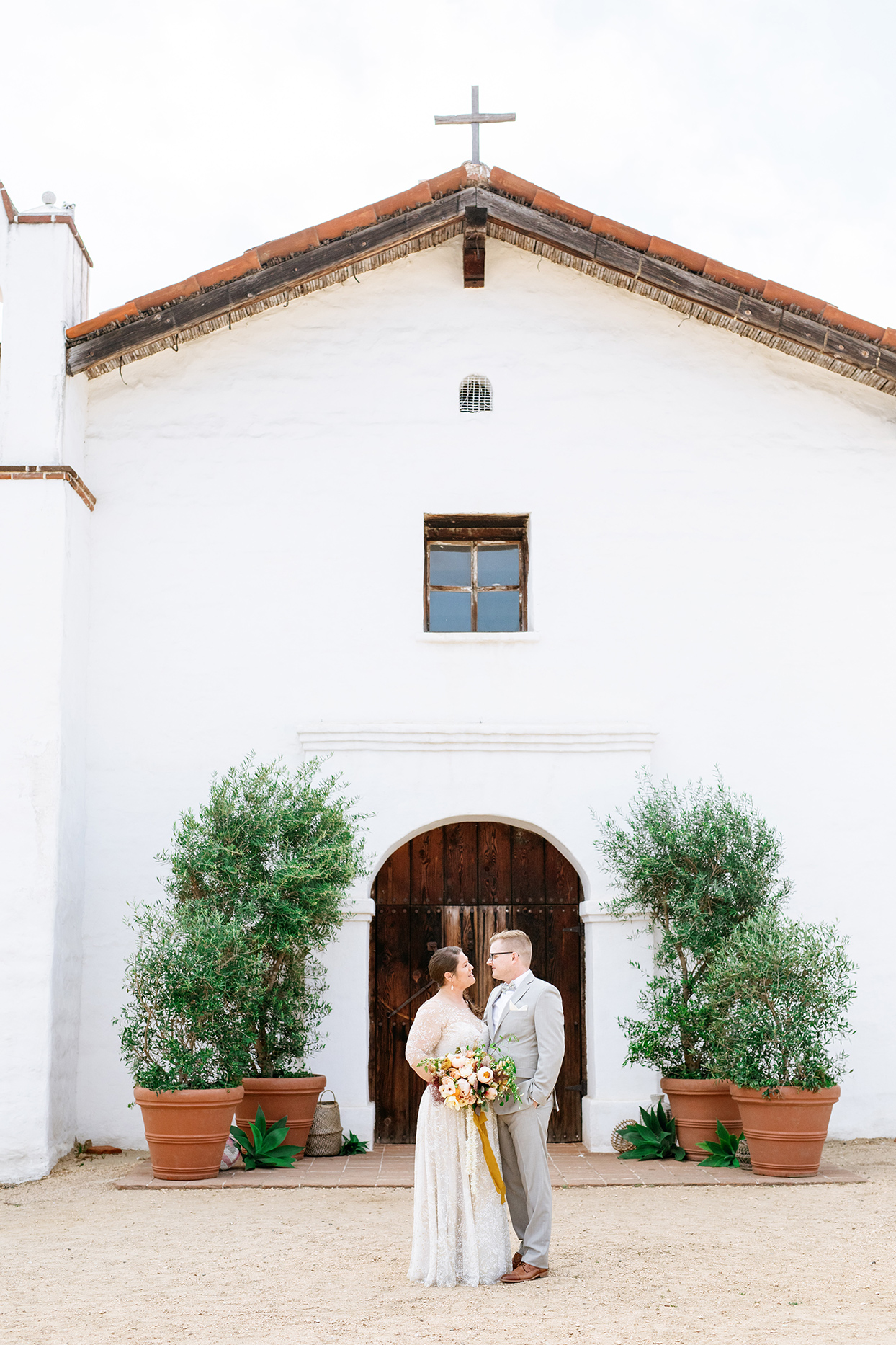 nina devon wedding couple in front of church