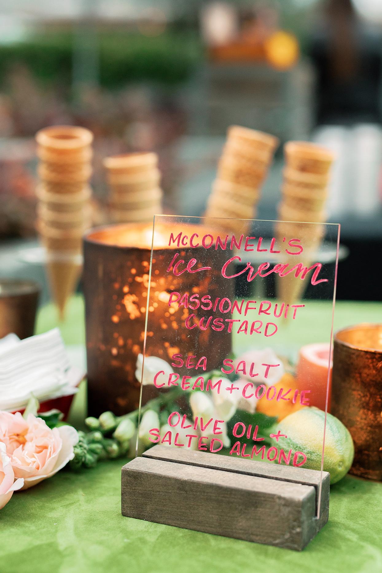 nina devon wedding dessert menu on transparent glass