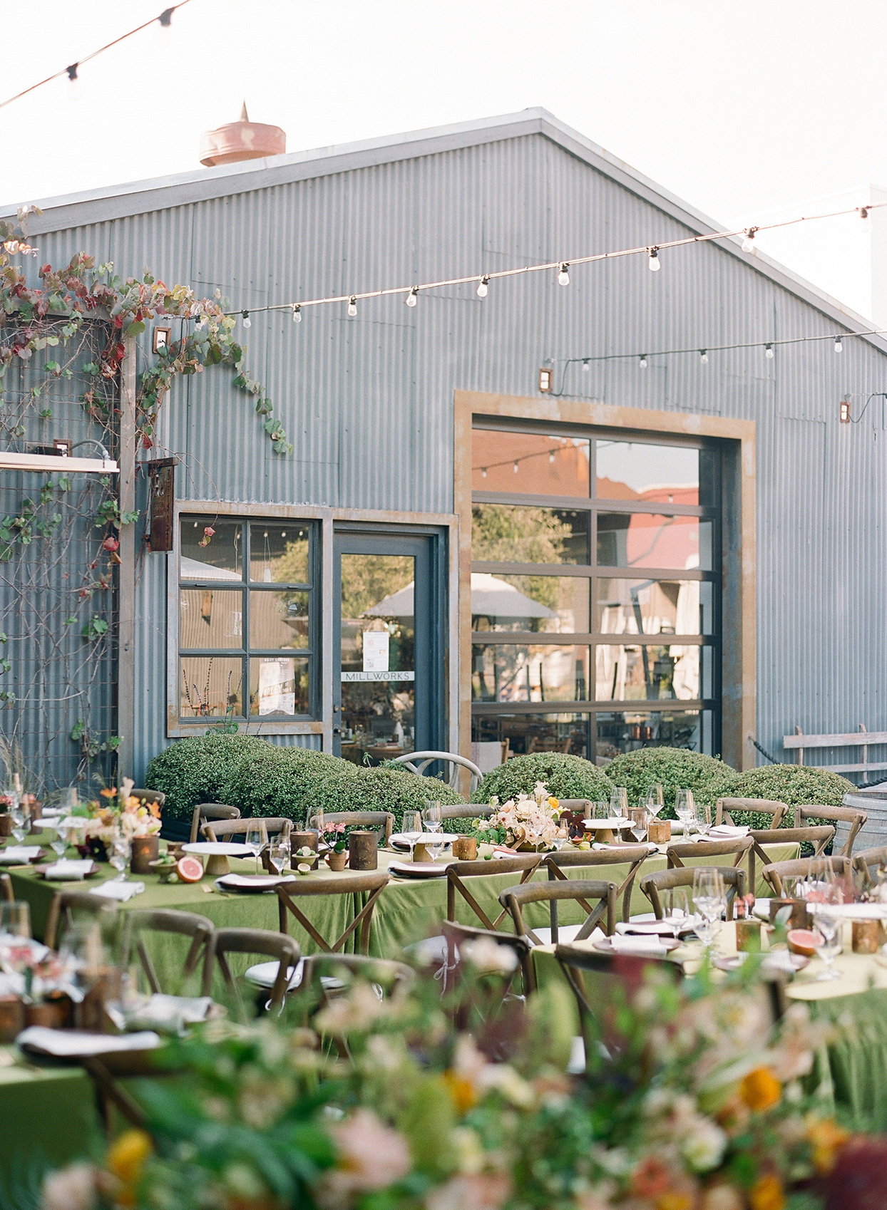 nina devon wedding long tables rustic setting