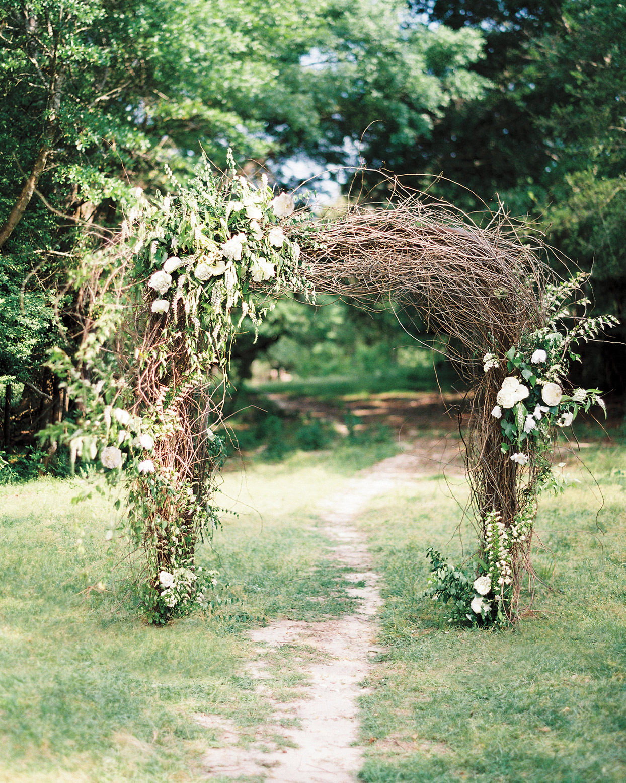 twig branch arch with flowers