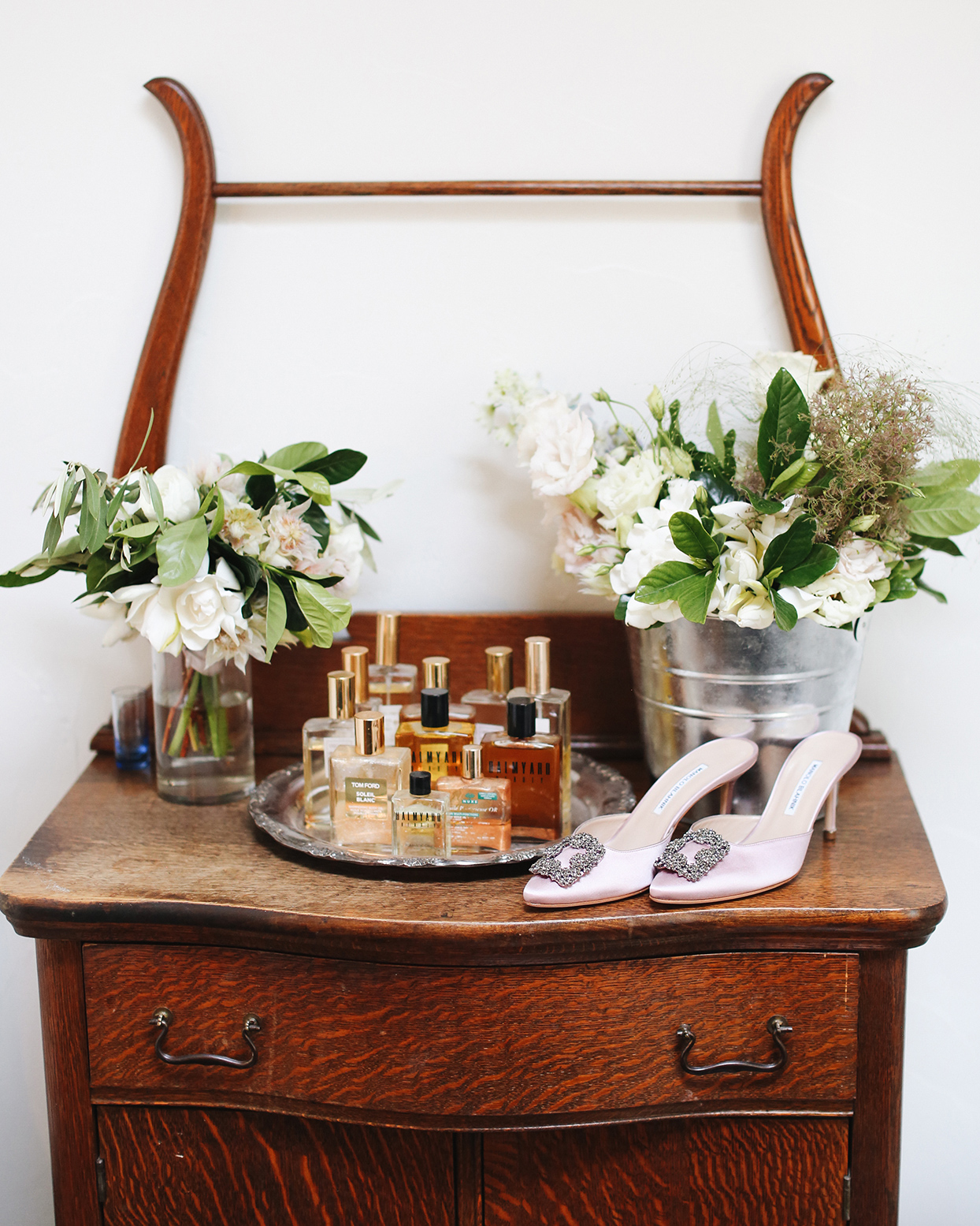 pia davide wedding bride's shoes on wooden dresser