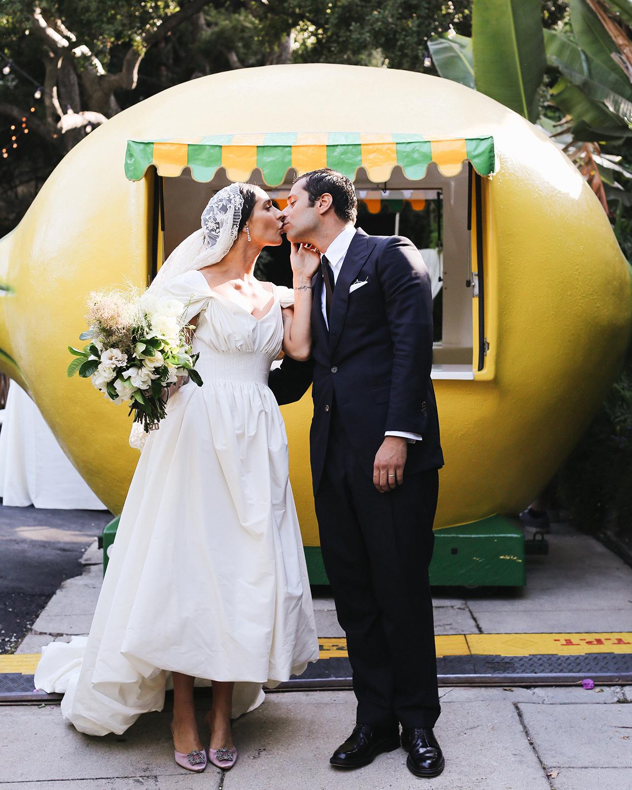 pia davide wedding couple in front of lemon car