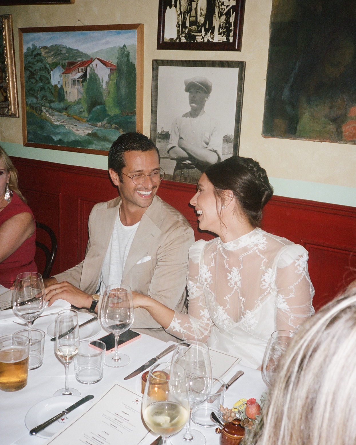 pia davide wedding rehearsal dinner couple at table