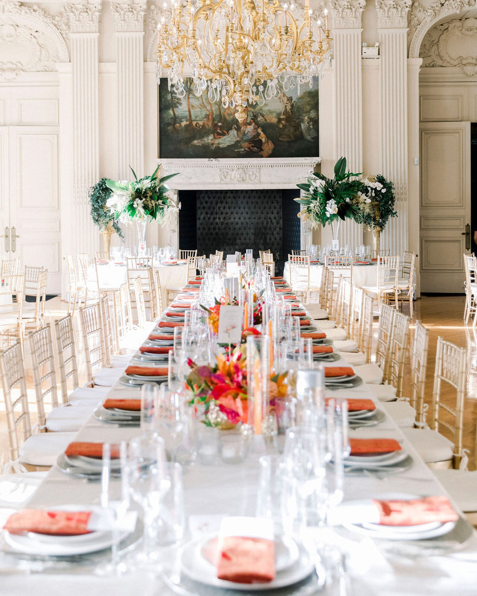 dalila elliot wedding reception long table with orange tropical decor