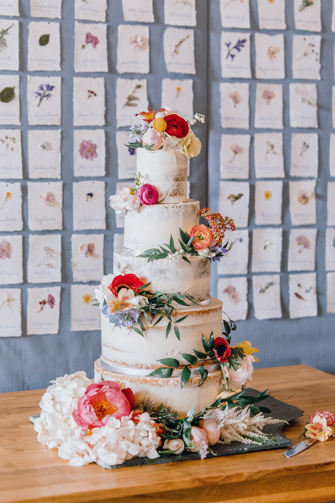 sem-naked five tier wedding cake with flowers