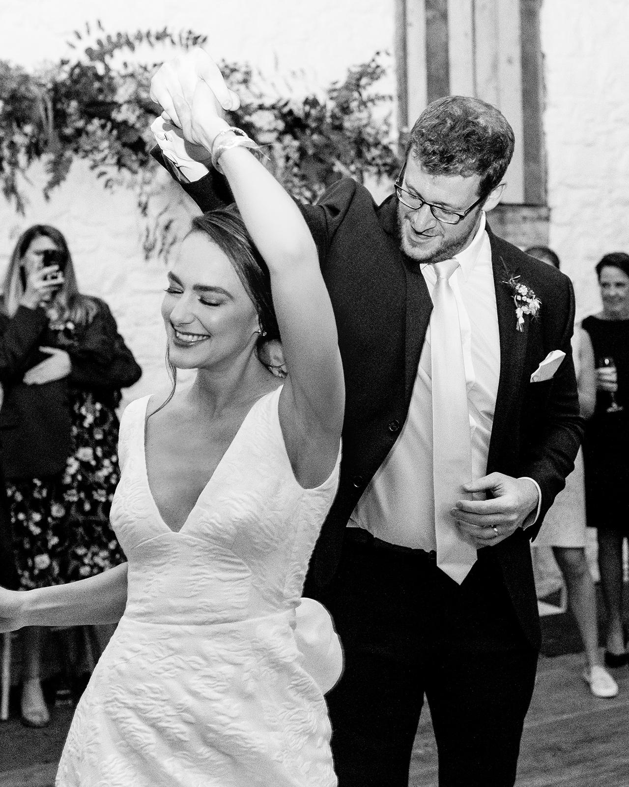 bride groom wedding reception dance twirl