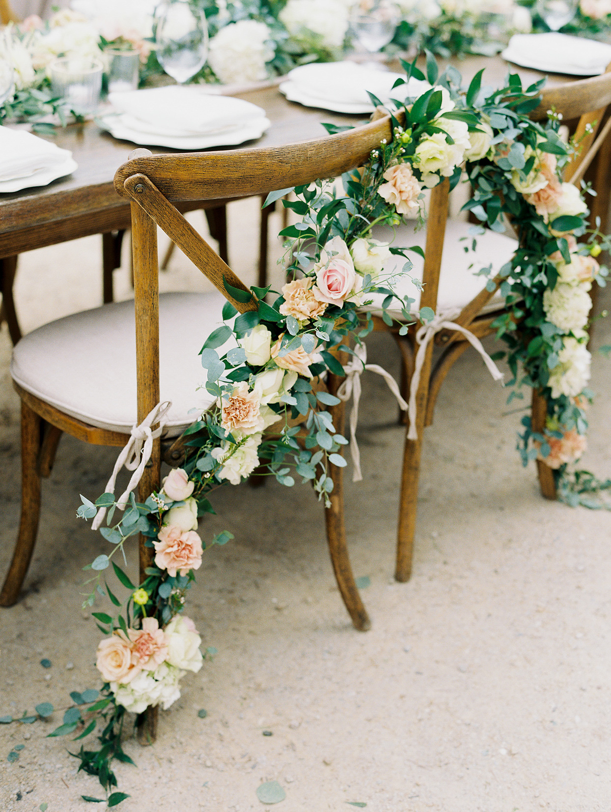 mika steve wedding chairs with floral garland
