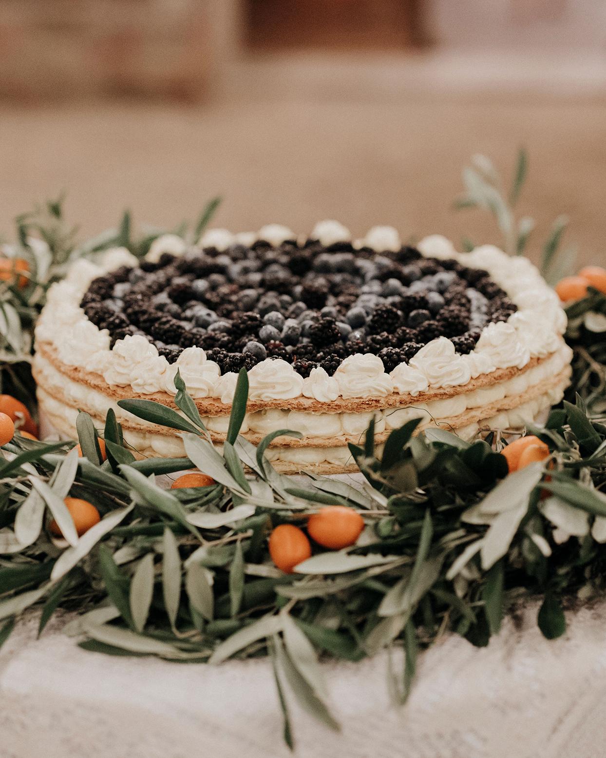 jaclyn antonio wedding layer cake with berries