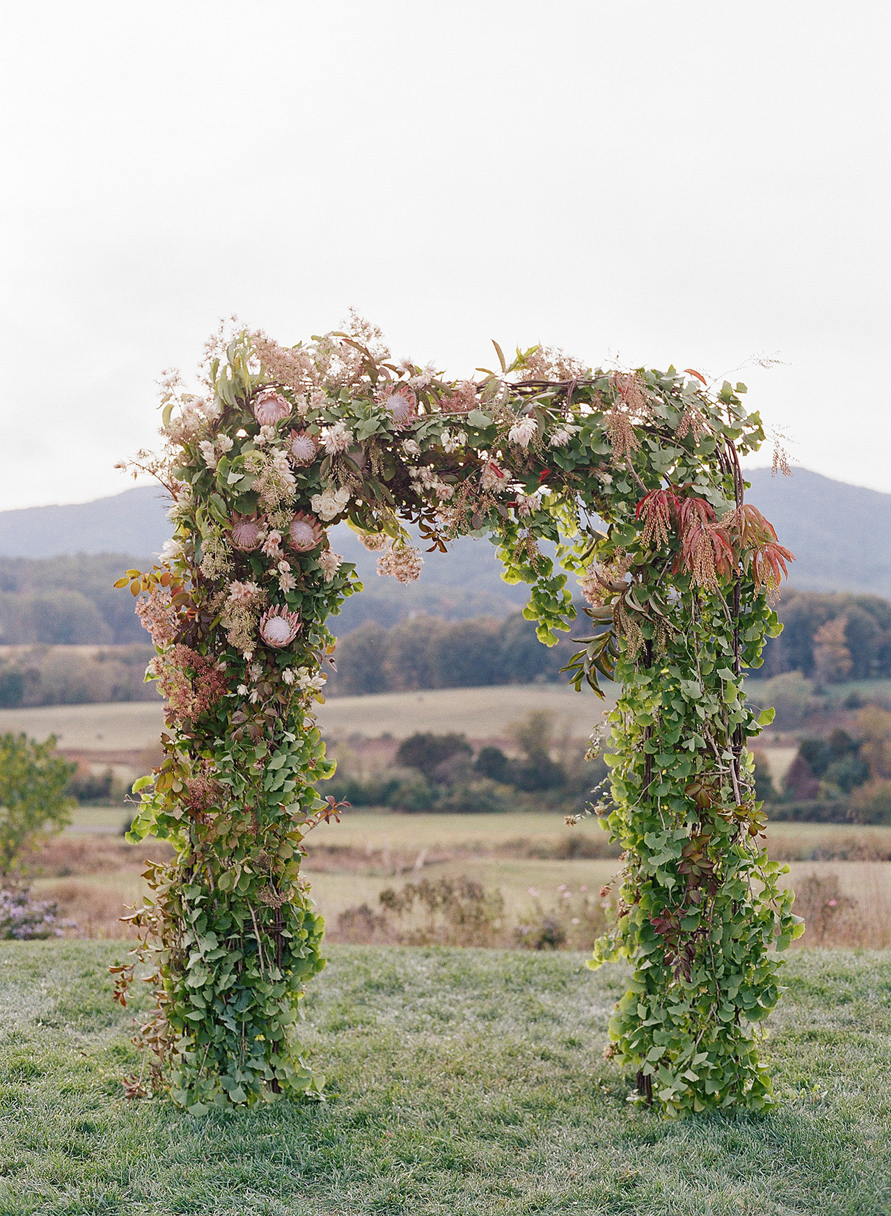 summer fall transitioned floral wedding arch