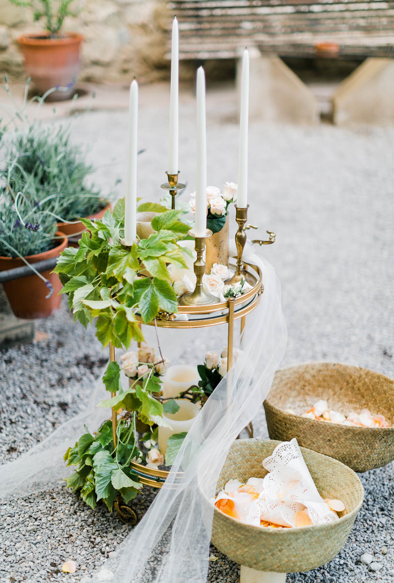 wetting petal baskets small table of greenery and candles