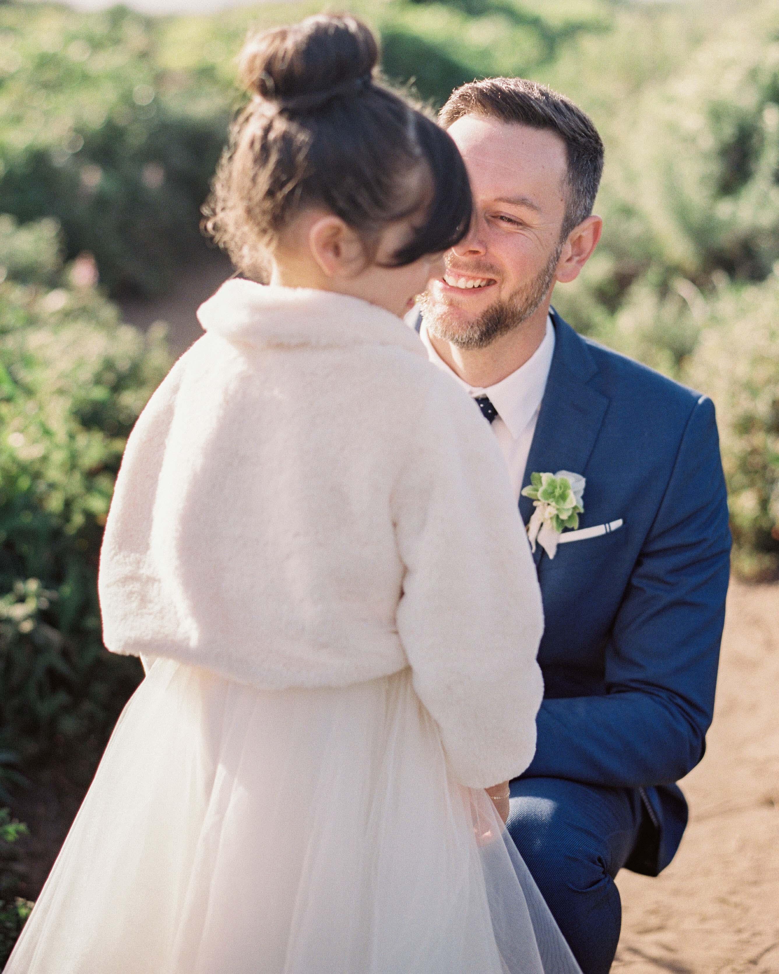 groom smiles at girl outside