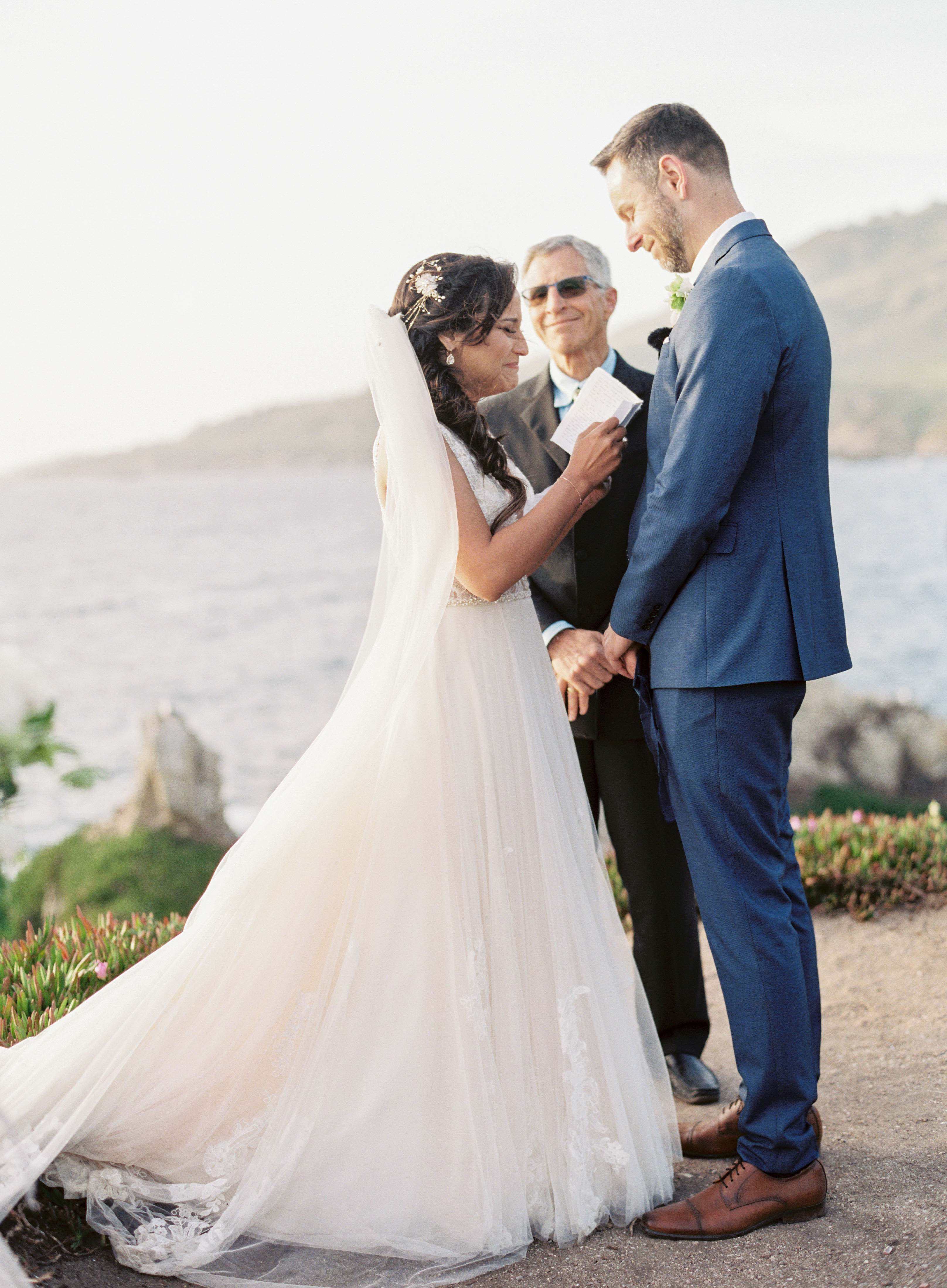 bride and groom exchange vows outside