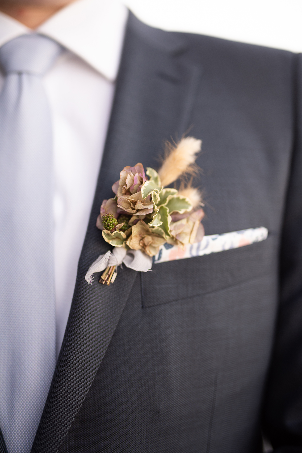 silk ribbon tied groom wedding boutonniere