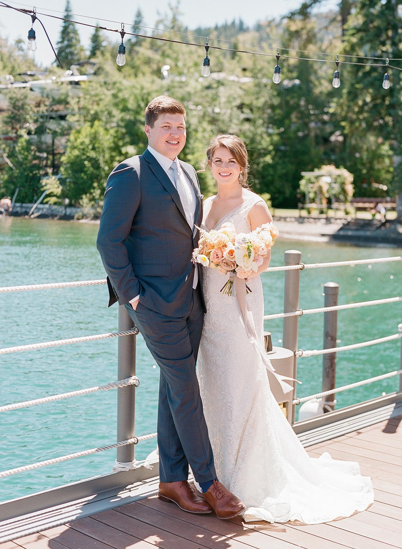 bride groom pose on lake dock forrest background