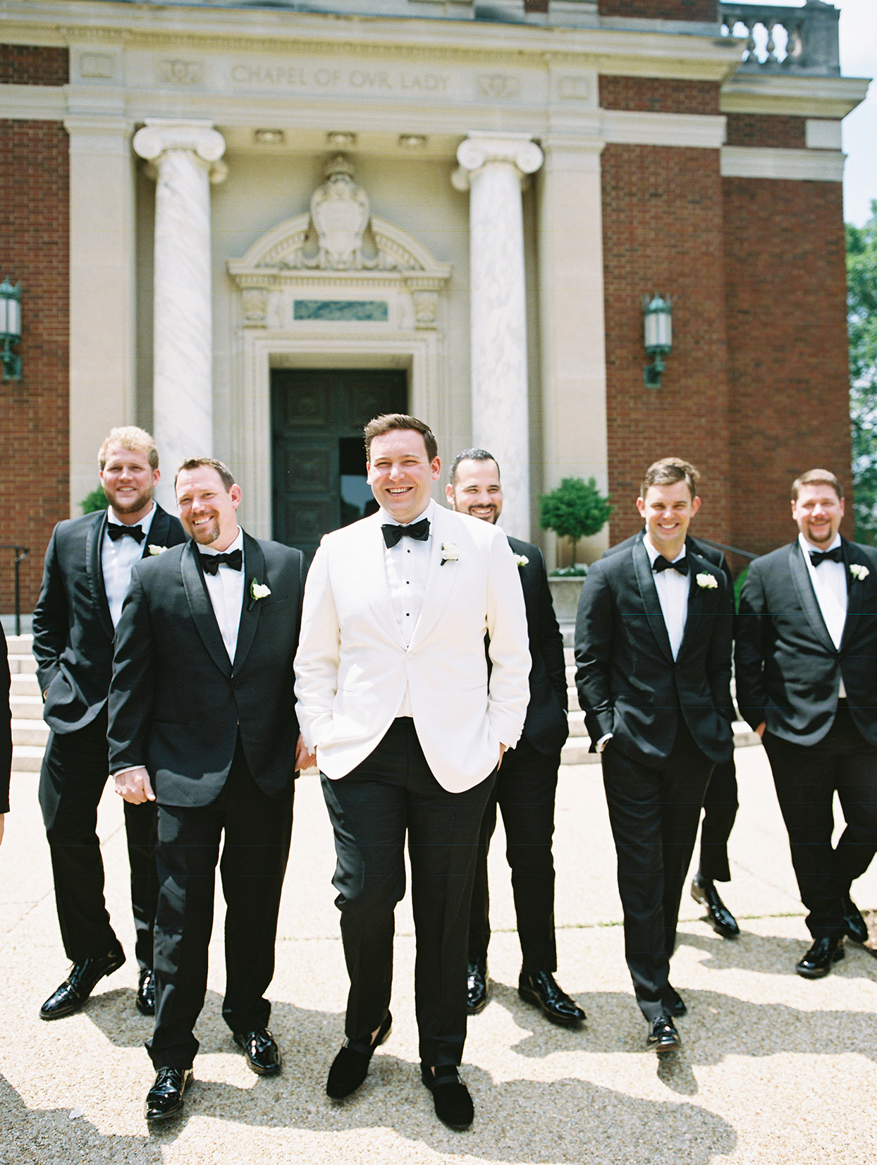gigi kyle wedding groom and groomsmen walking