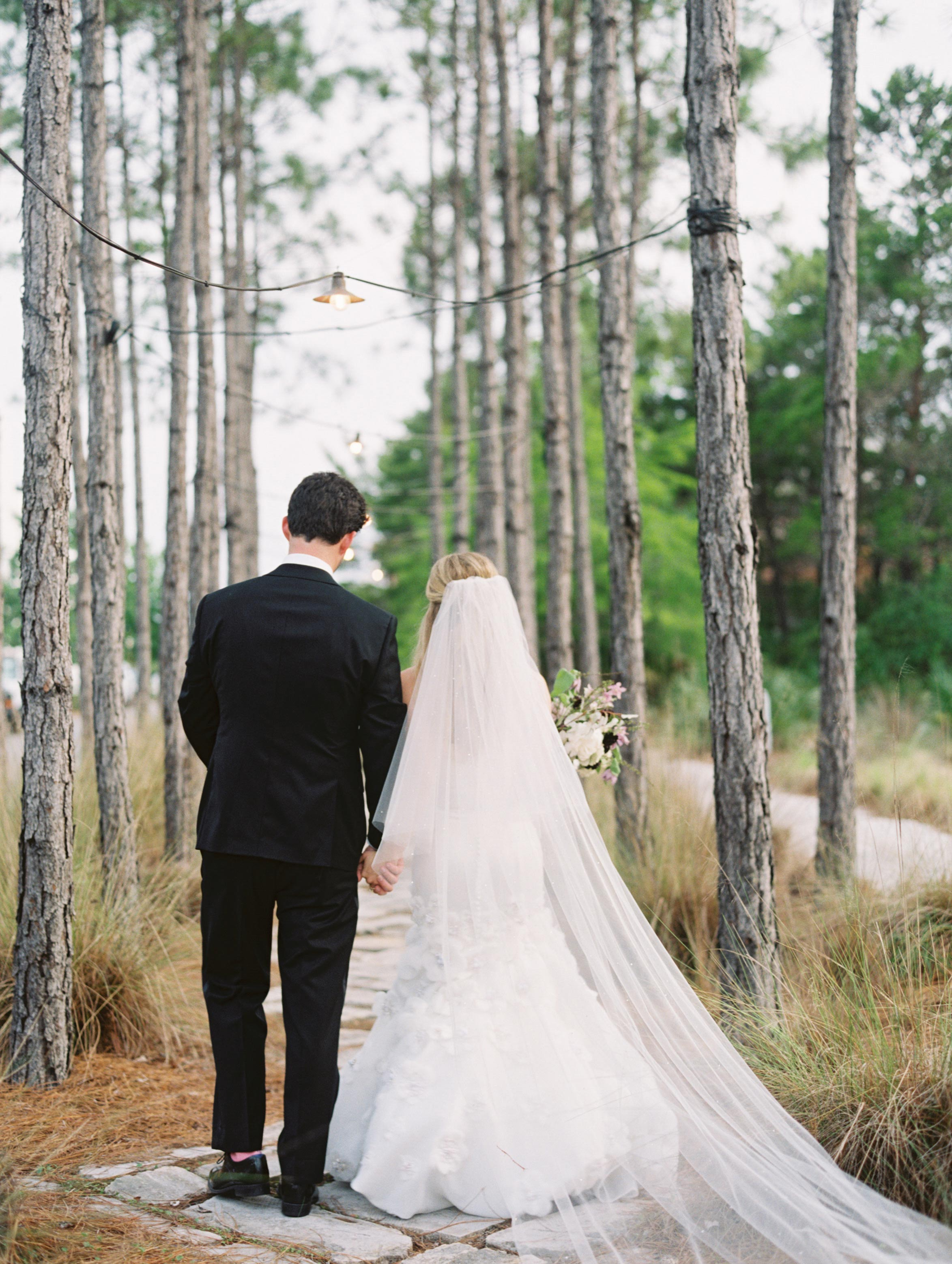 leighton craig wedding couple walking down path